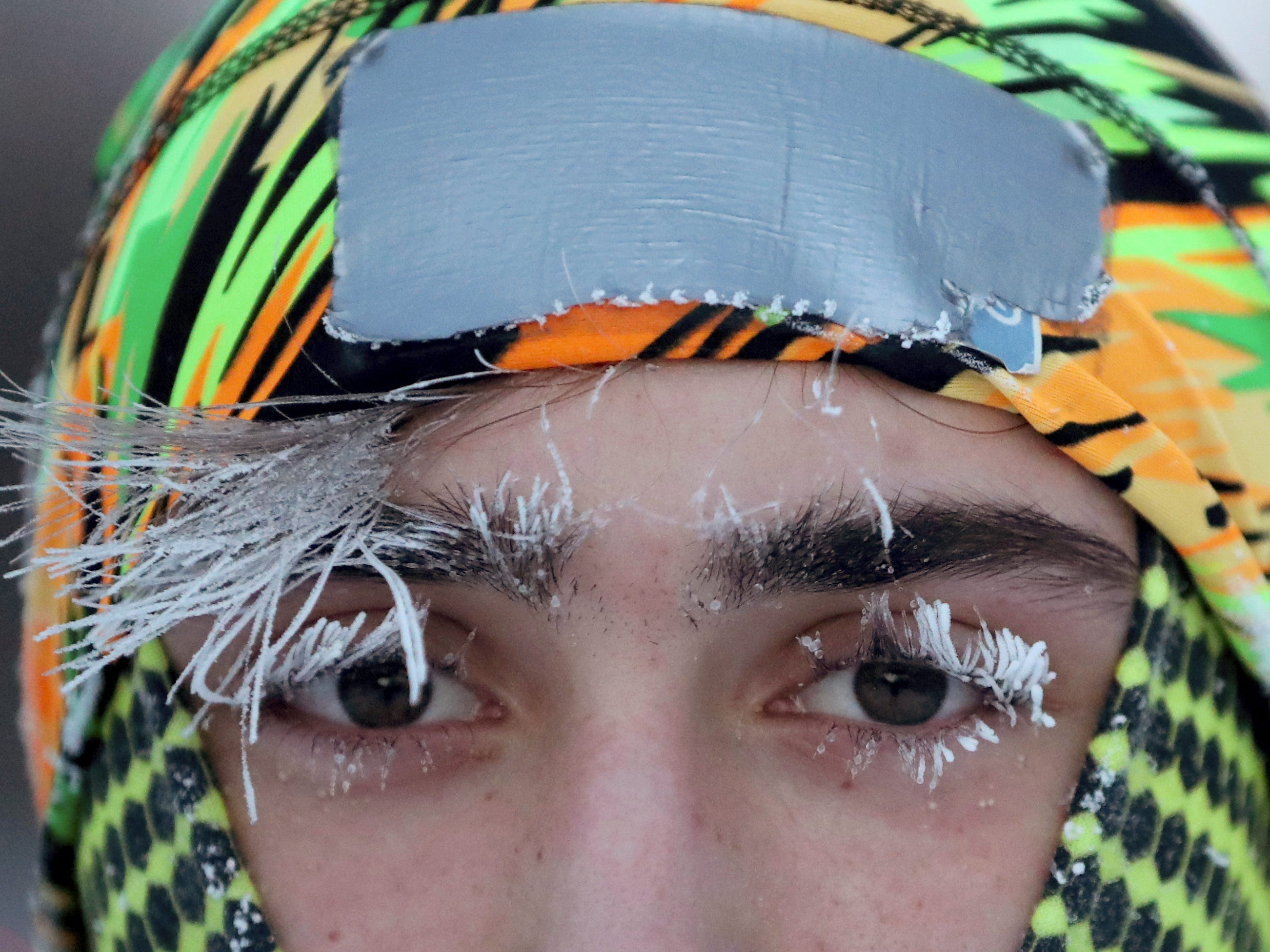 Frost covers part of the face of University of Minnesota student Daniel Dylla during a morning jog along Mississippi River Jan. 29, 2019, In Minneapolis. Extreme cold and record-breaking temperatures are crawling into parts of the Midwest after a powerful snowstorm pounded the region, and forecasters warn that the frigid weather could be life-threatening.