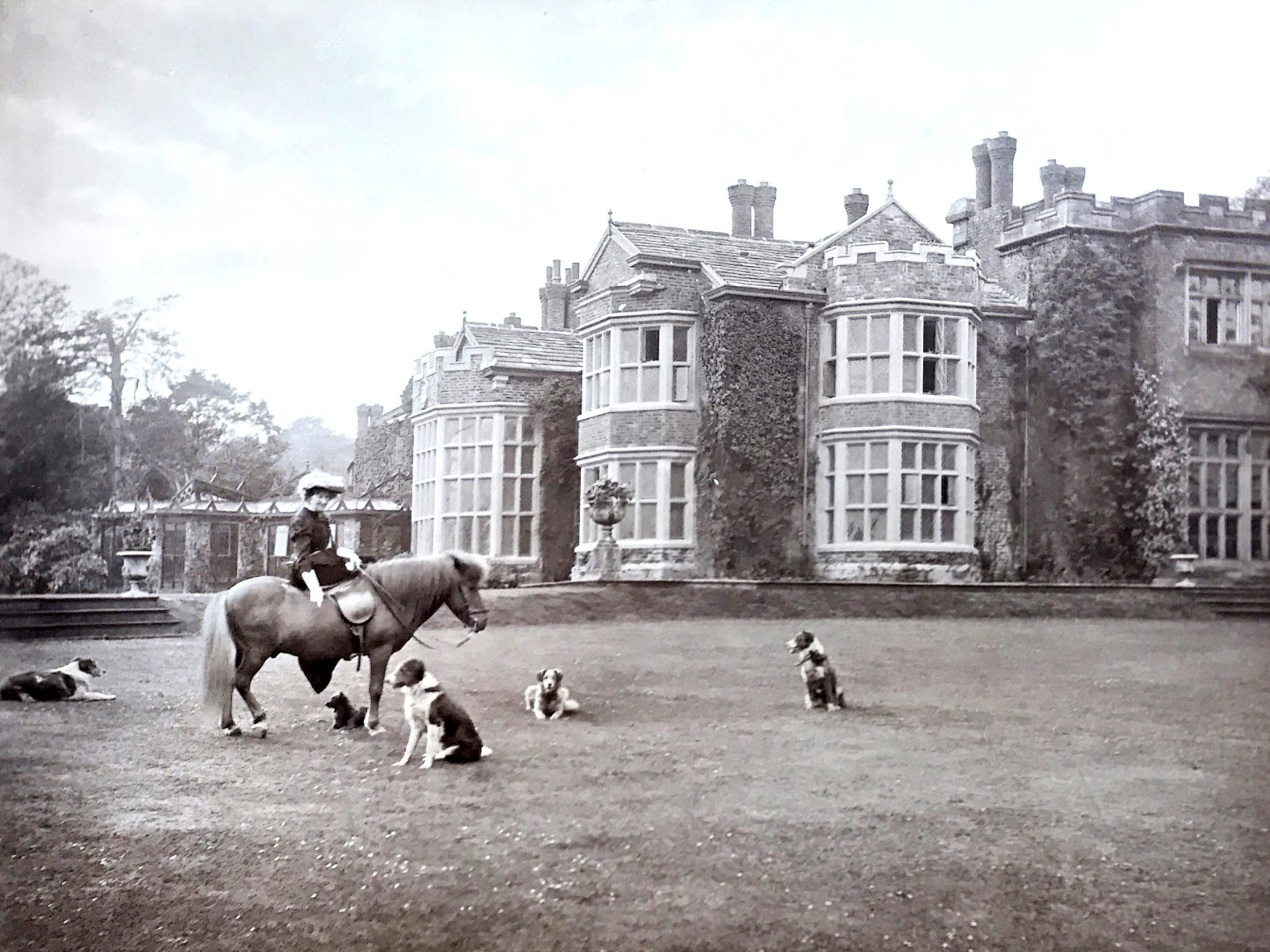 A vintage photograph on the grounds of Hopwood Hall in 1908.