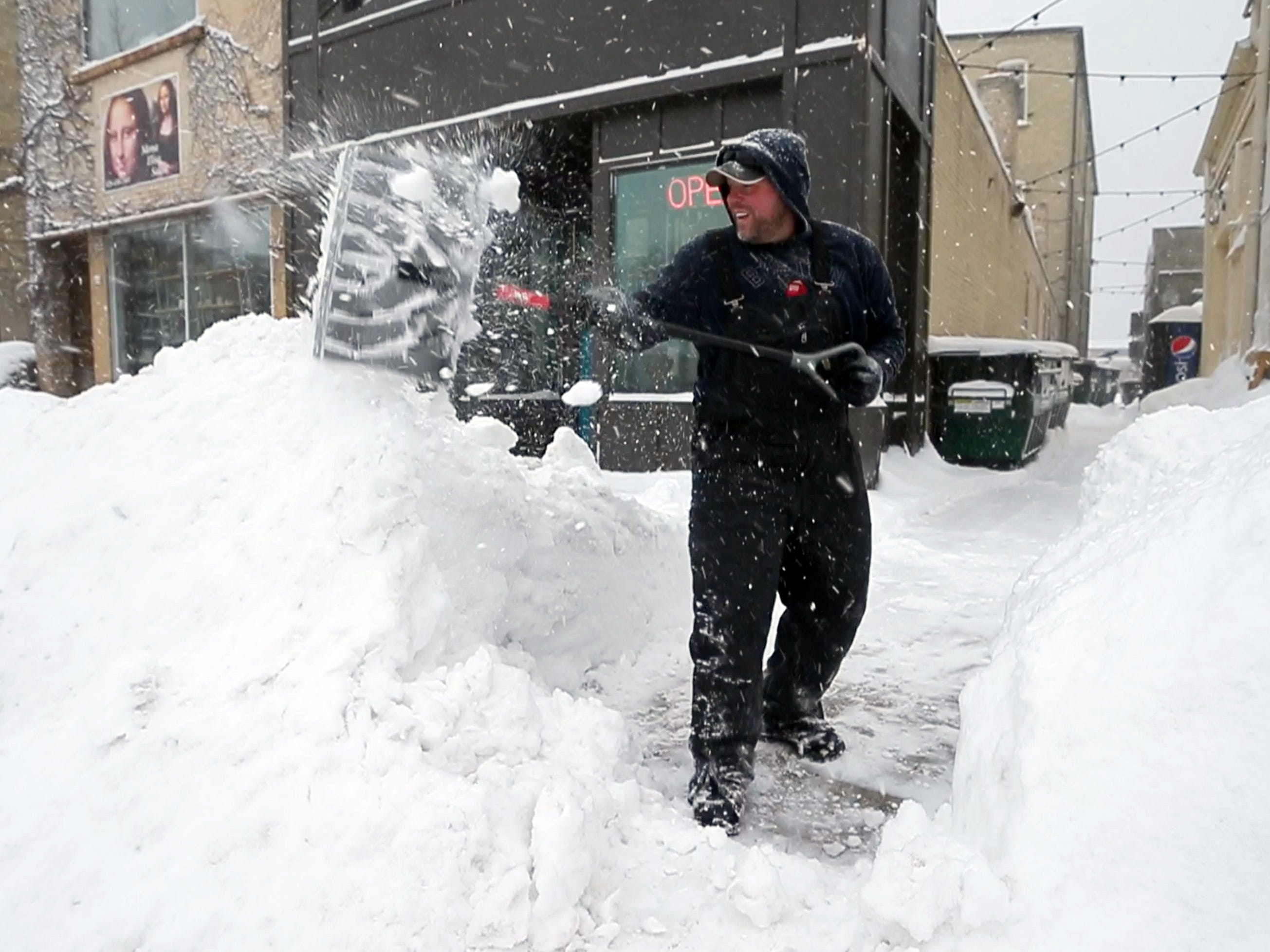 Robert McNitt shovels snow after work in Sheboygan, Wis. McNitt, a snow plow operator, said he spent 18 hours moving snow for the City of Sheboygan.