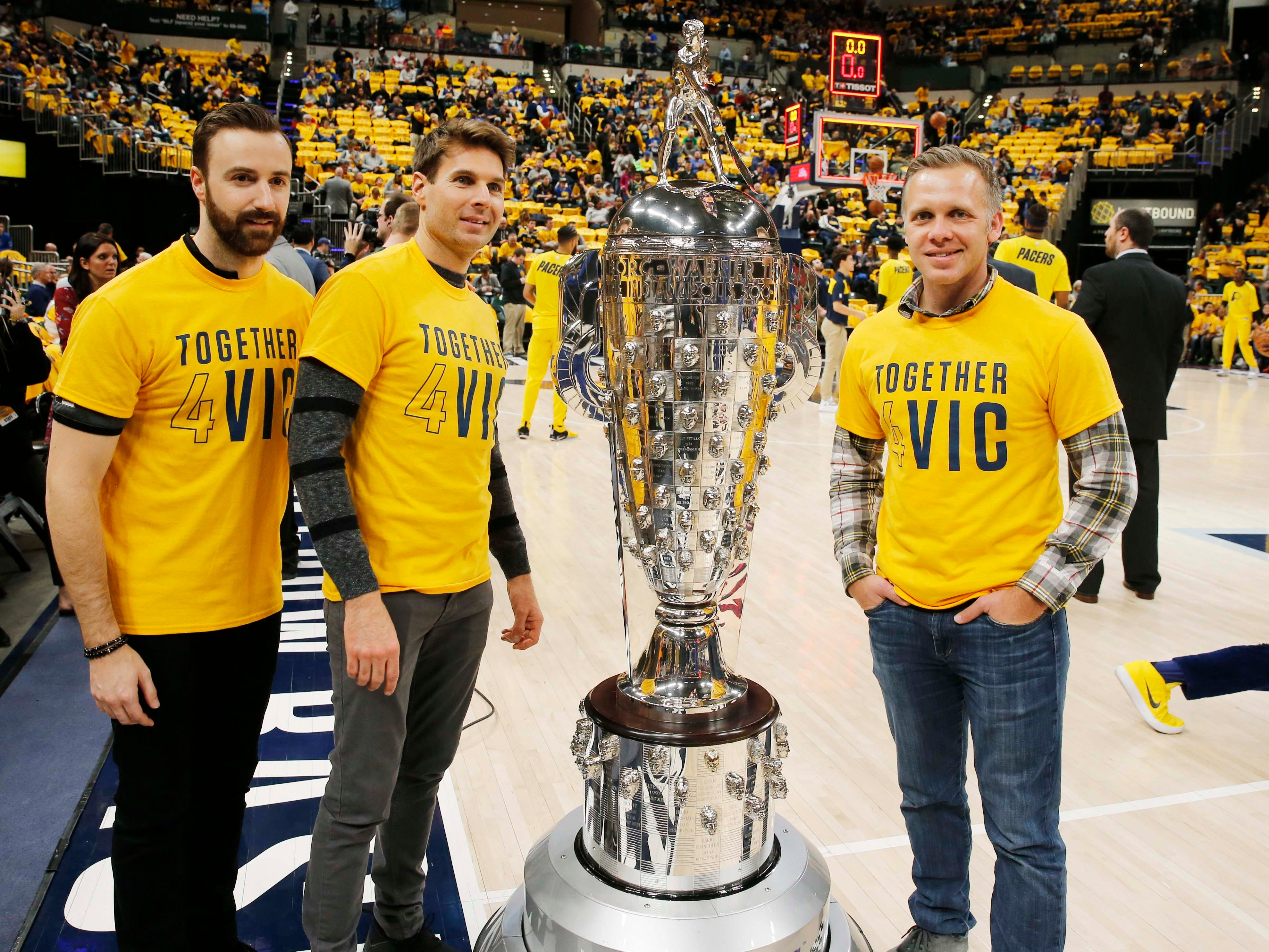 Jan. 28: IndyCar drivers, from left, James Hinchcliffe, Will Power and Ed Carpenter pose with the Borg Warner Trophy, awarded to the winner of the Indianapolis 500, at Bankers Life Fieldhouse before the Pacers play the Warriors.