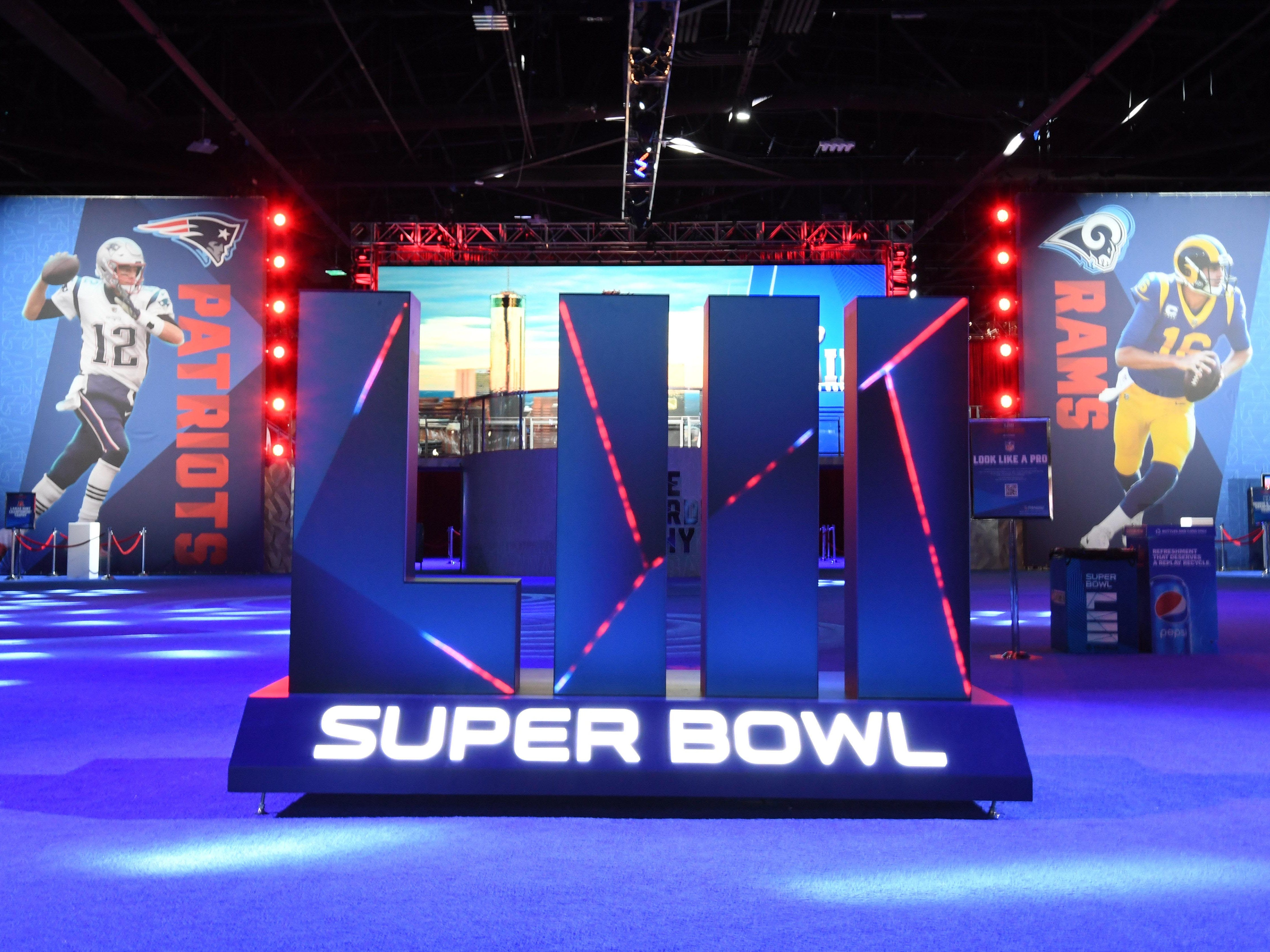 General overall view of Super Bowl LIII letters and images of New England Patriots quarterback Tom Brady (12) and Los Angeles Rams quarterback Jared Goff (16) at the NFL Experience at the Georgia World Congress Center.