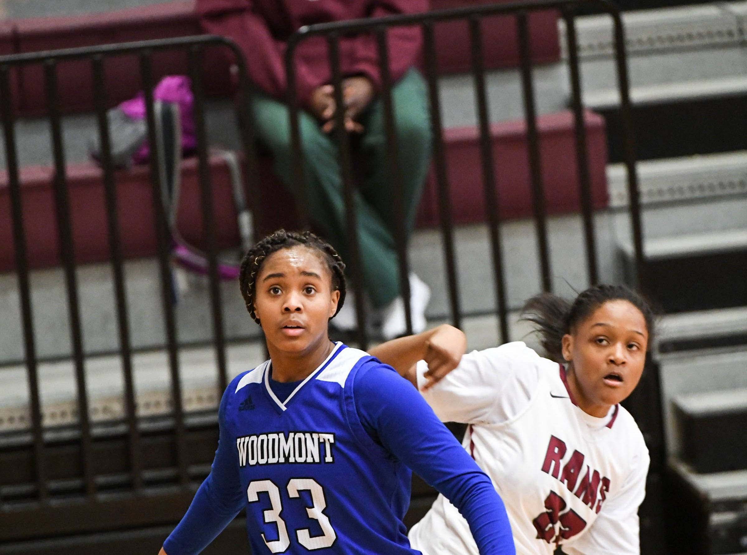Westside freshman Keazia Hatten(23) watches her three-point shot go in near Woodmont senior Kitara Henry(33) during the first quarter at Westside High School in Anderson on Tuesday.