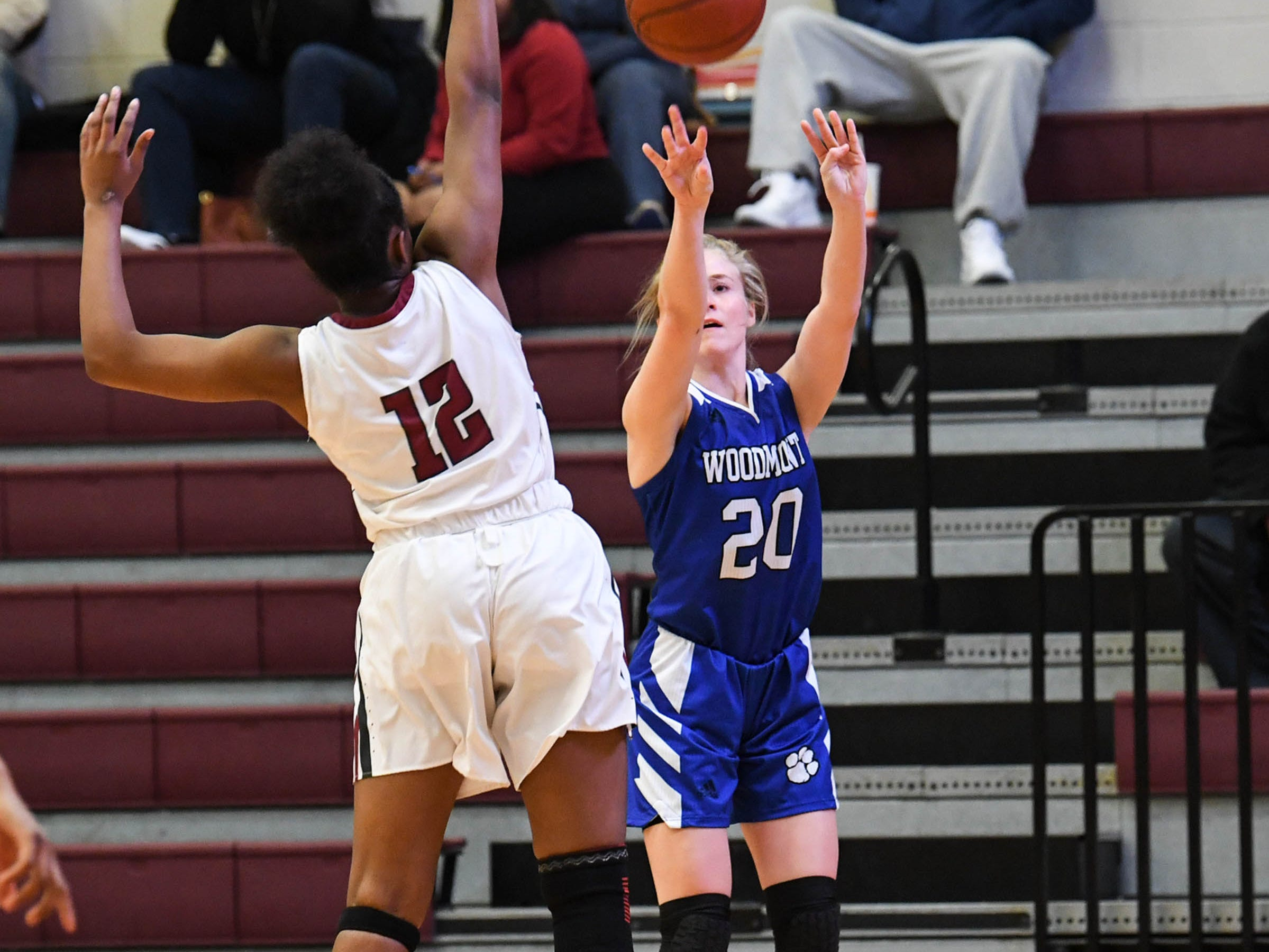 Woodmont senior Xan Rowland(20), right, shoots a three-pointer near Westside freshman Branya Pruitt(12) during the first quarter at Westside High School in Anderson on Tuesday.