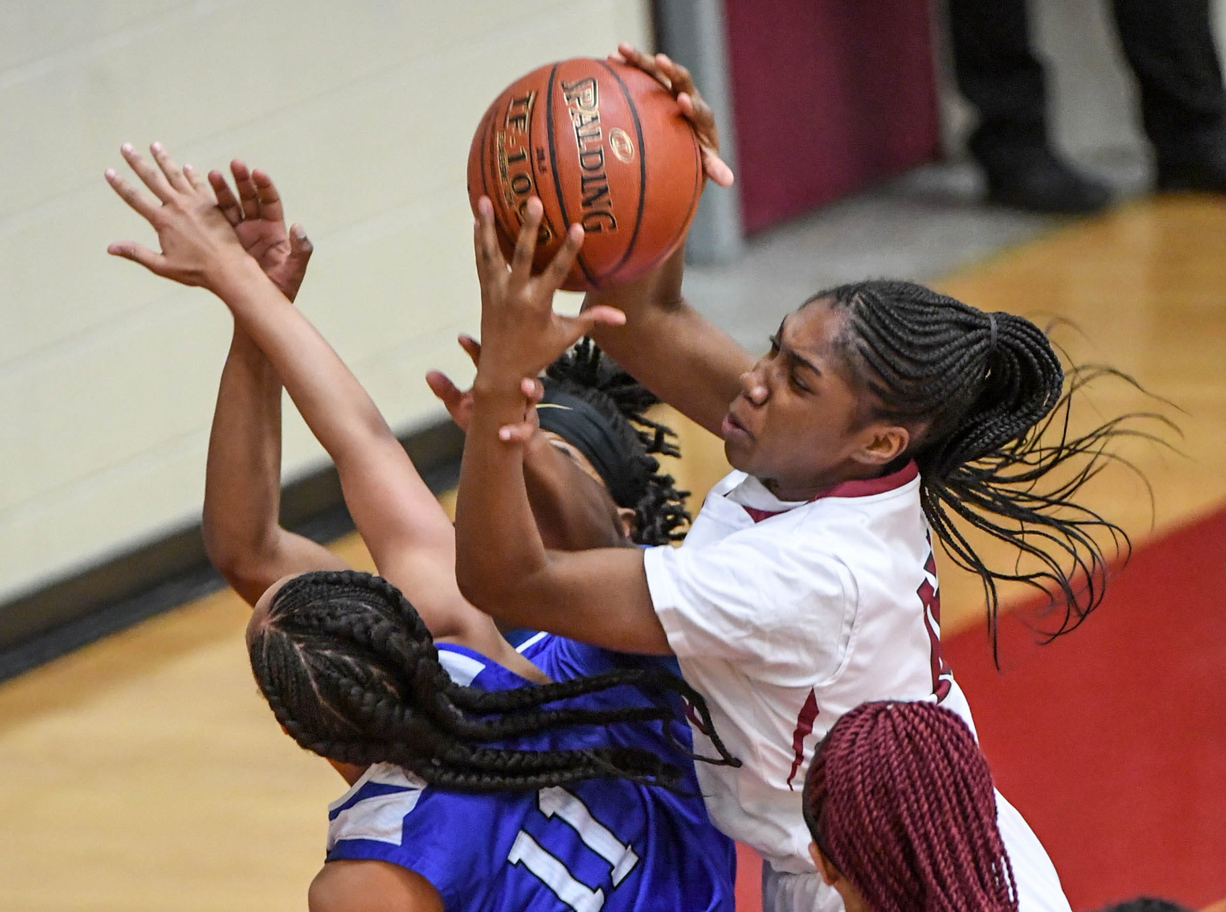 Westside freshman Branya Pruitt(12) rebounds near Woodmont junior Anzya Cook(11) during the first quarter at Westside High School in Anderson on Tuesday.