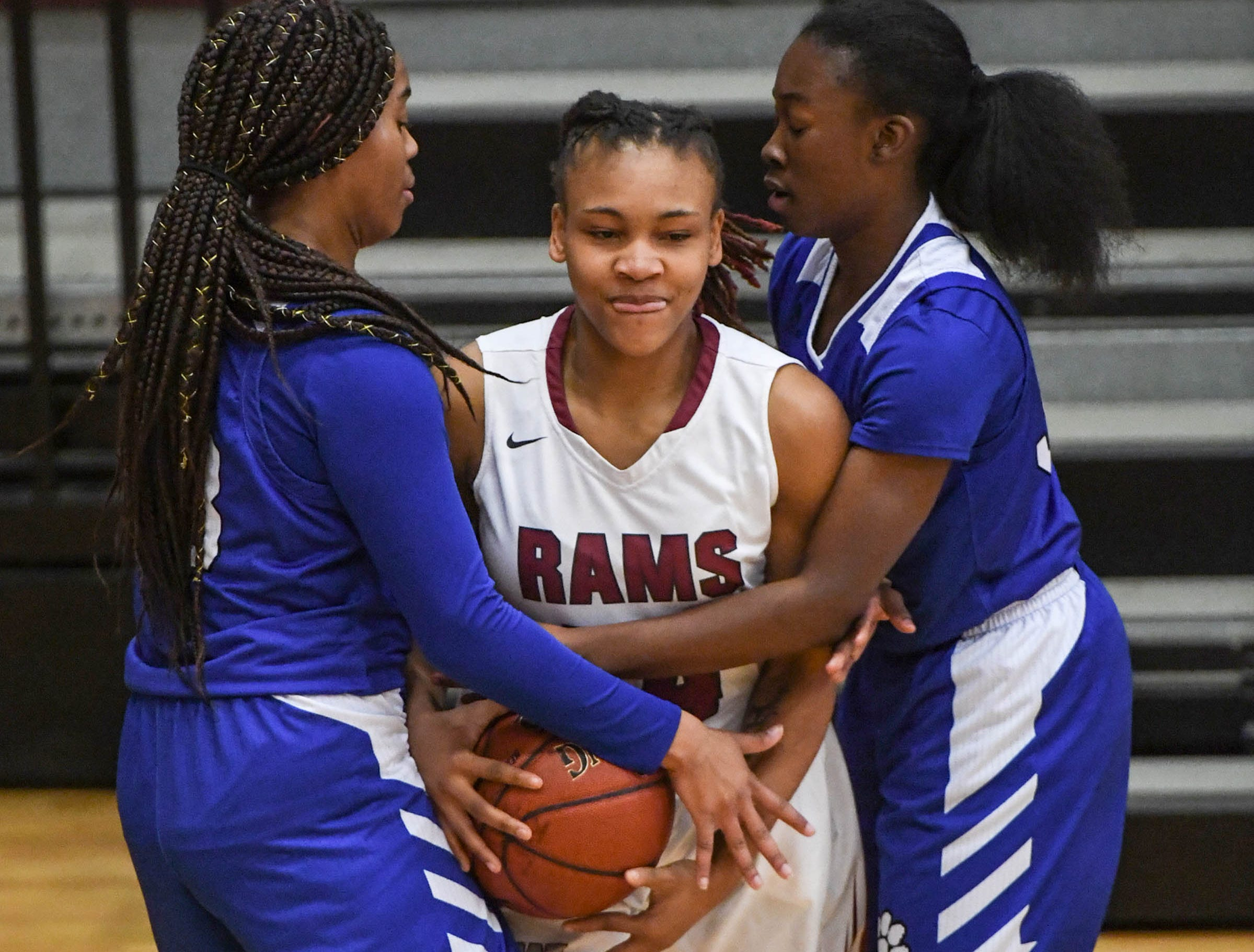 Westside junior Tatyana Lewis(14) is trapped by Woodmont senior Kitara Henry(33), left, and Woodmont junior JaRae Smith(30), right, during the first quarter at Westside High School in Anderson on Tuesday.