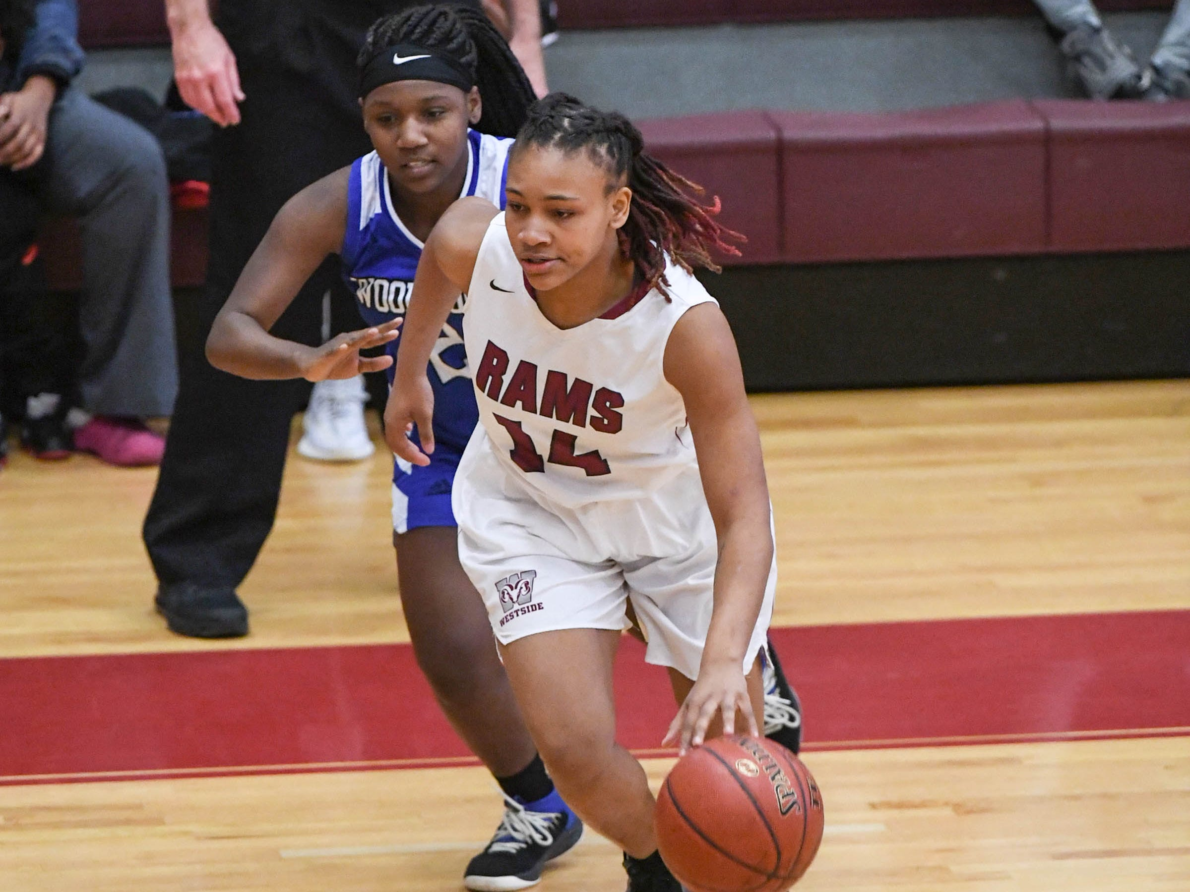 Westside junior Tatyana Lewis(14) dribbles around Woodmont junior Jordan Hagood(4) during the first quarter at Westside High School in Anderson on Tuesday.