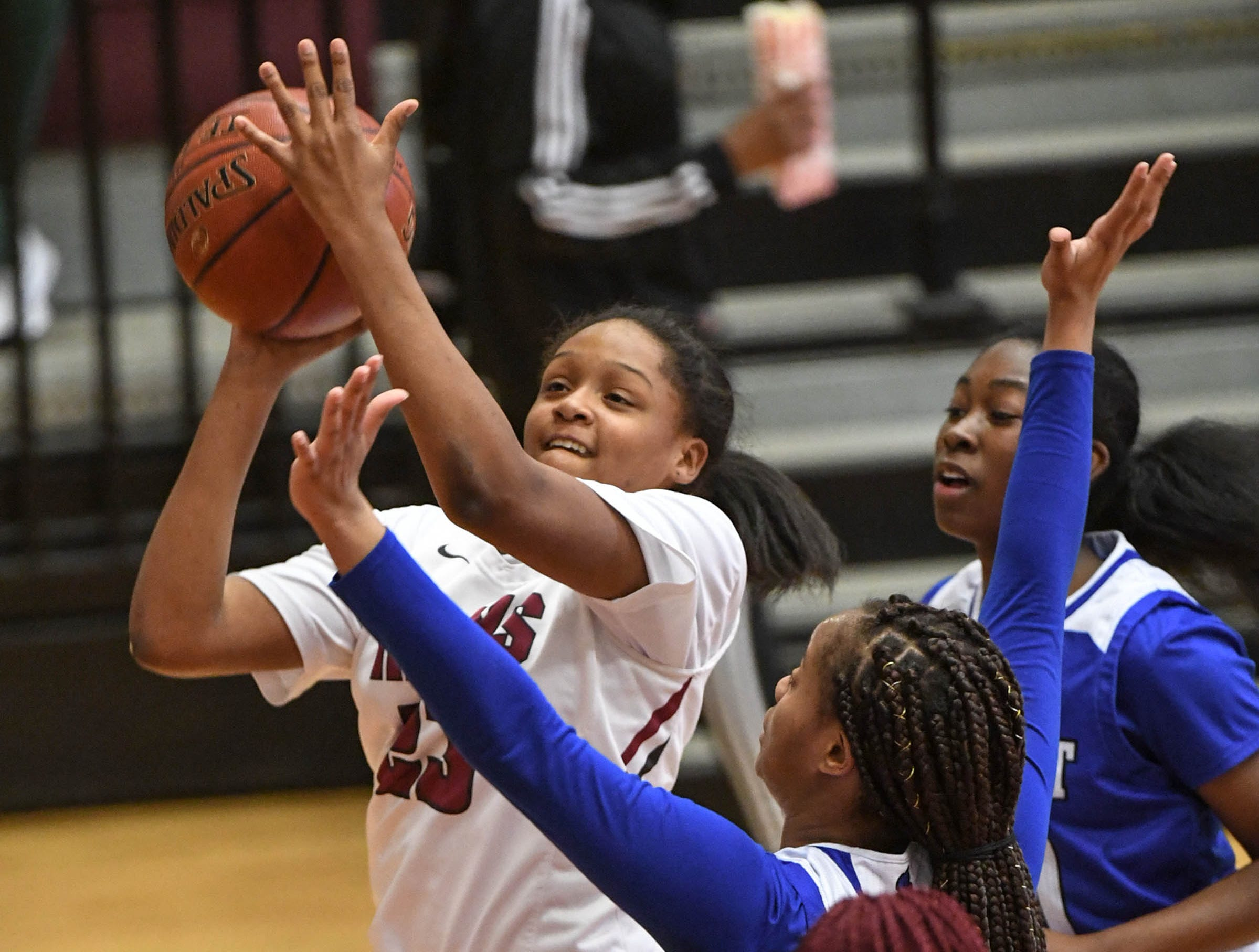 Westside freshman Keazia Hatten(23) shoots near Woodmont junior JaRae Smith(30) during the first quarter at Westside High School in Anderson on Tuesday.