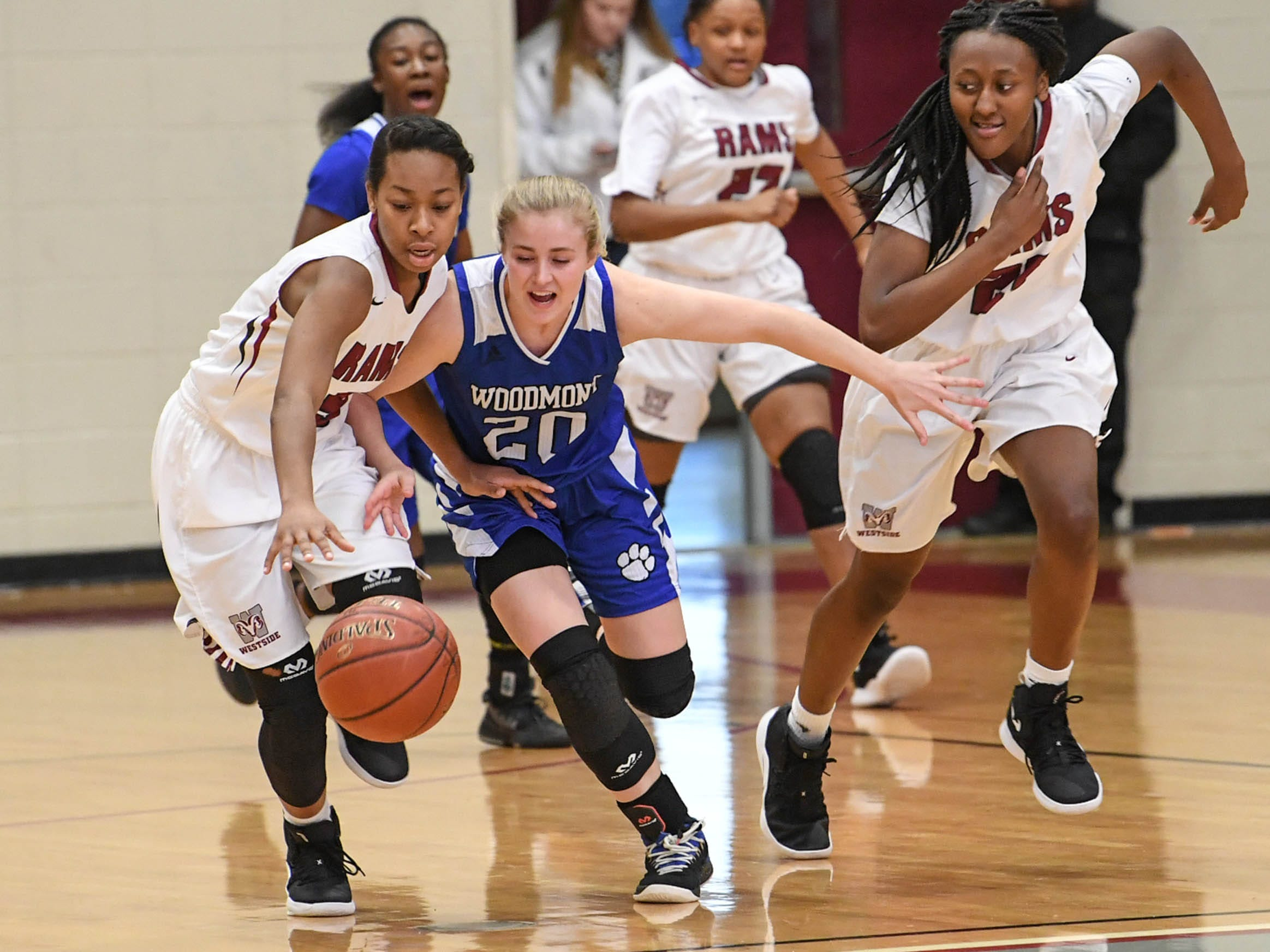 Westside senior Chelsea Adger(5), left, and Woodmont senior Xan Rowland(20)reach for a loose ball during the first qua rter at Westside High School in Anderson on Tuesday.