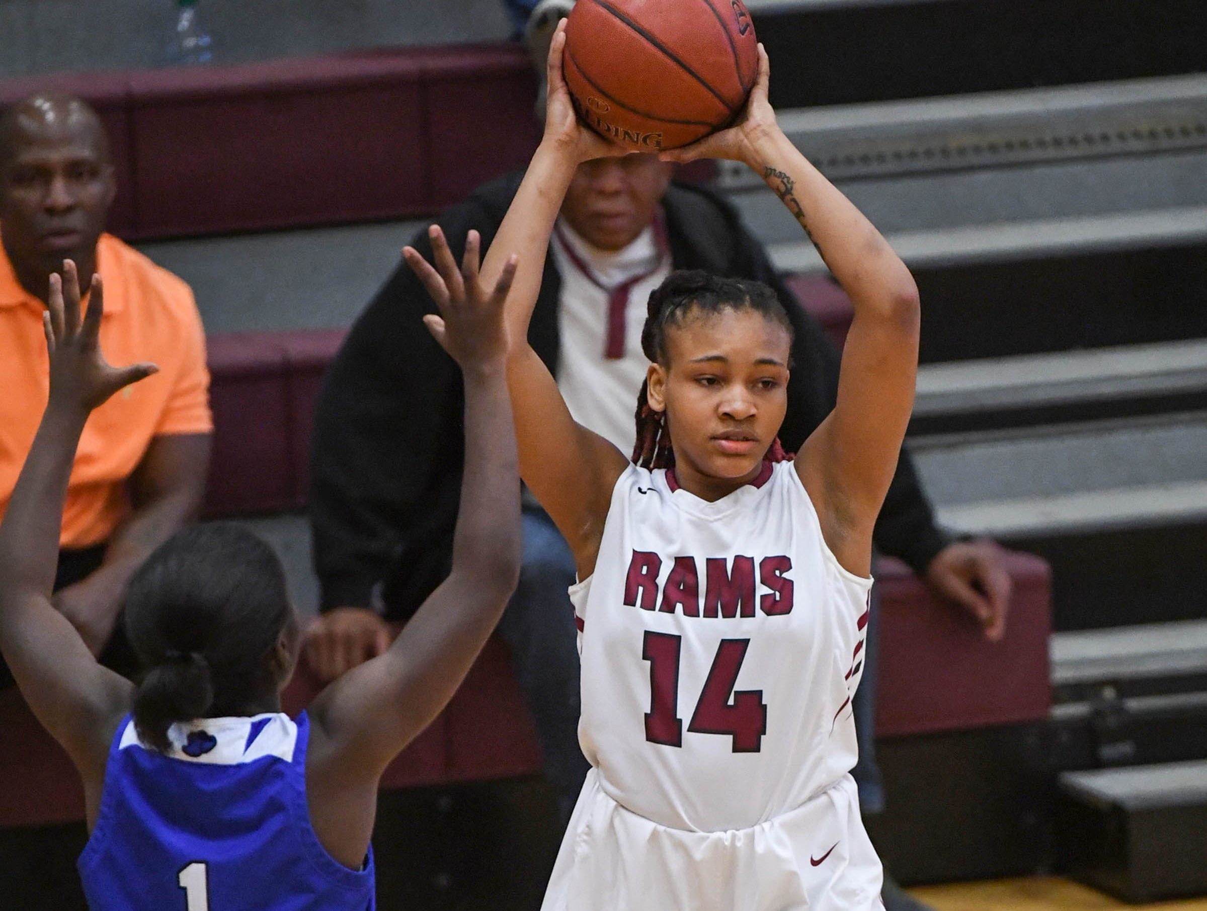 Westside junior Tatyana Lewis(14) gets ready to pass near Woodmont freshman Mazari Bennett(1) during the first quarter at Westside High School in Anderson on Tuesday.