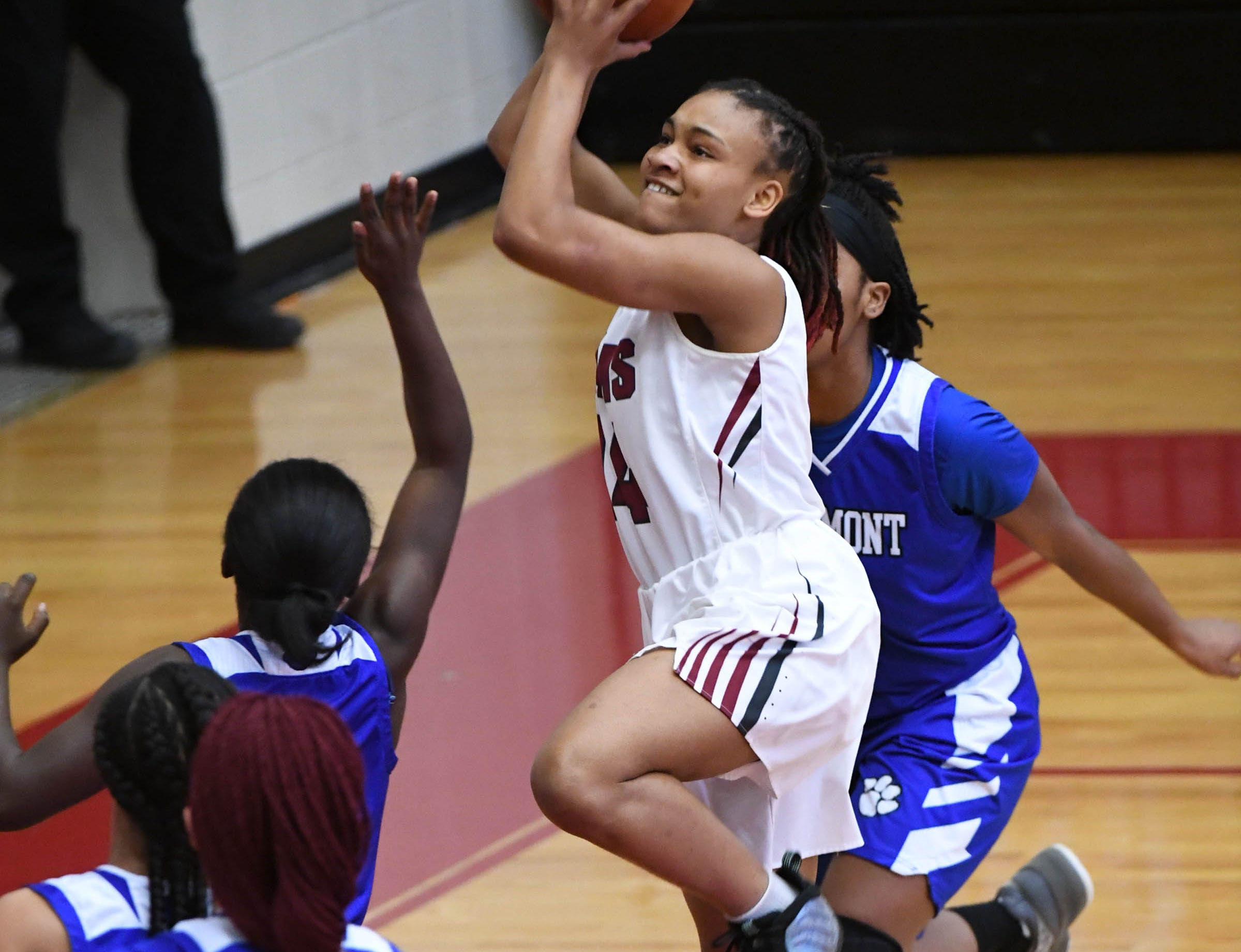 Westside junior Tatyana Lewis(14) shoots near Woodmont junior Sydney Wyatt(21) during the first quarter at Westside High School in Anderson on Tuesday.