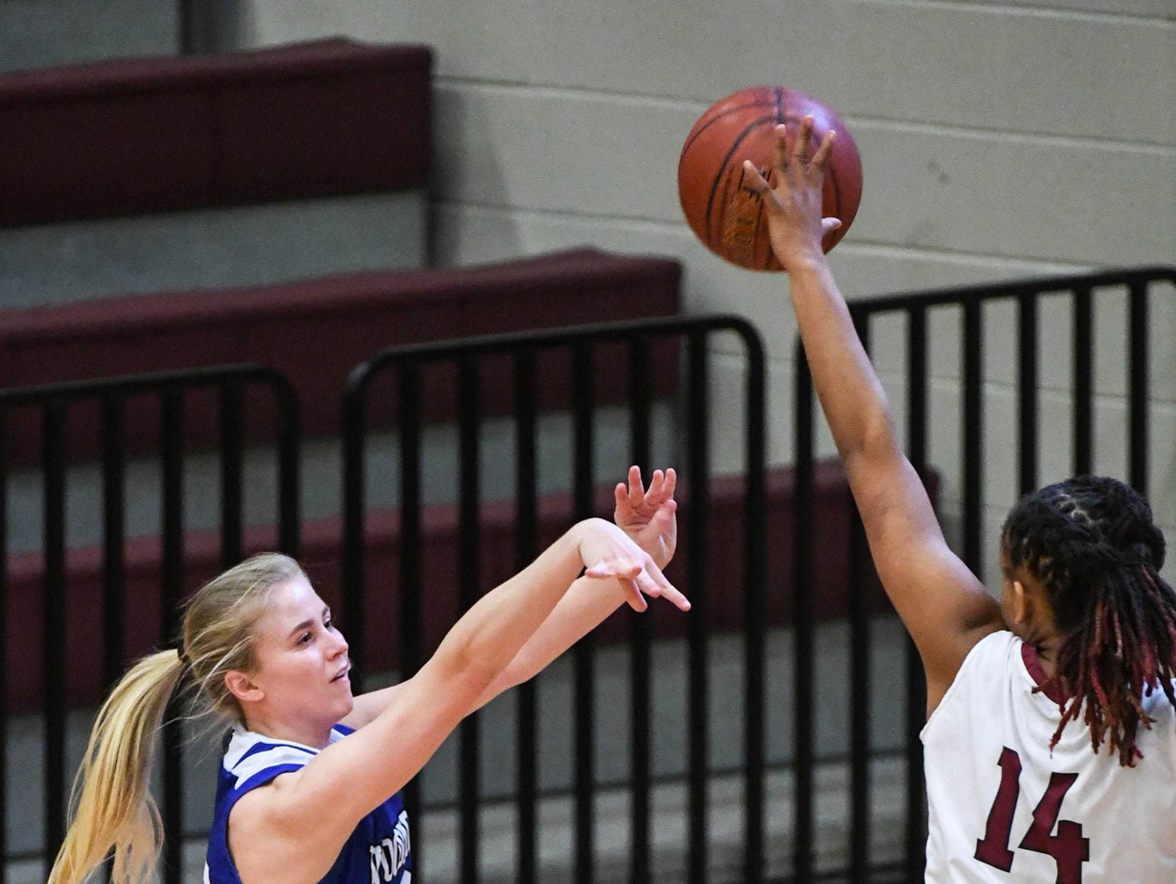 Woodmont senior Xan Rowland(20) shoots a three-pointer near Westside junior Tatyana Lewis(14) during the first quarter at Westside High School in Anderson on Tuesday.