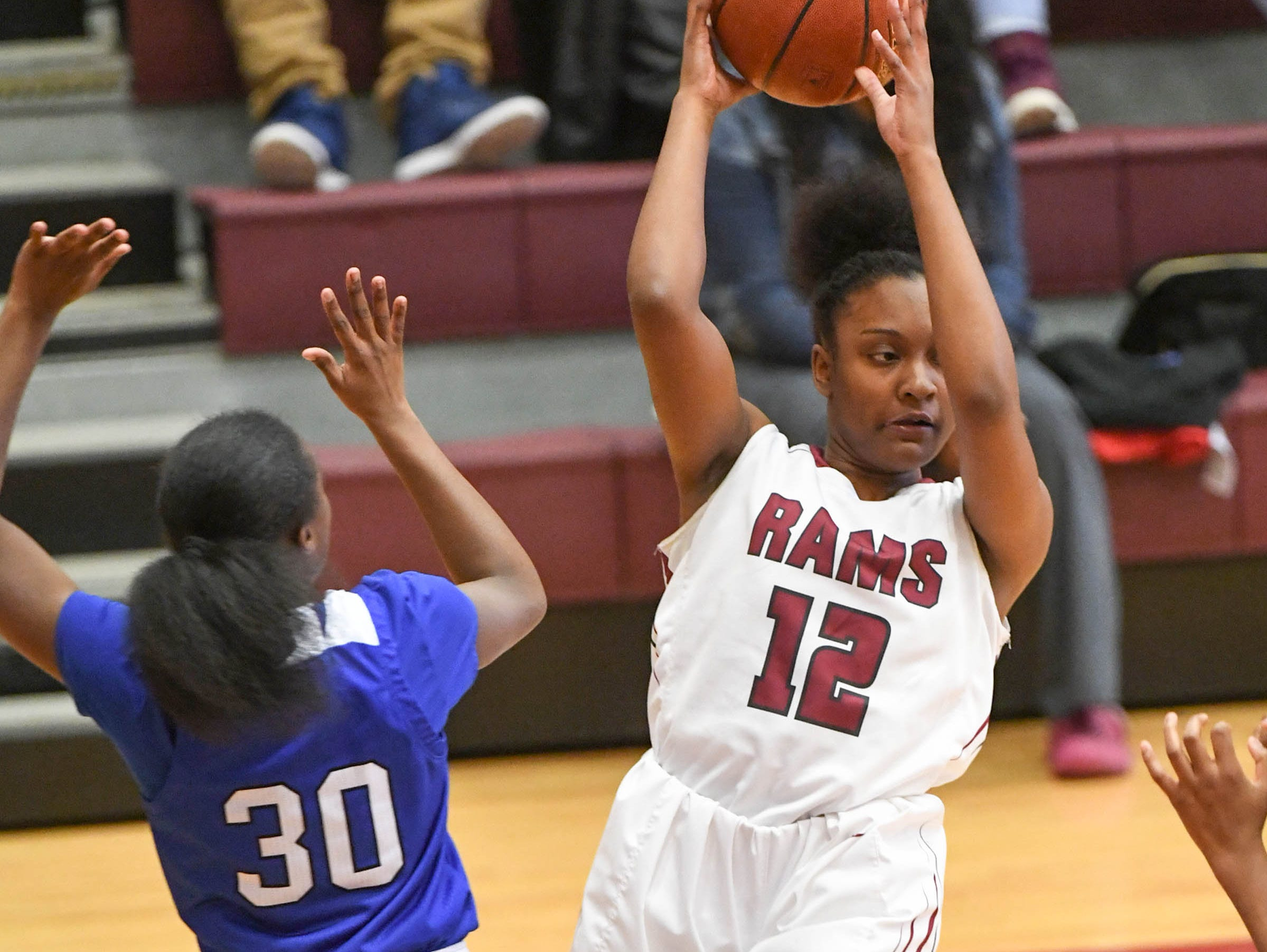 Westside freshman Branya Pruitt(12) rebounds near Woodmont junior JaRae Smith(30) during the first quarter at Westside High School in Anderson on Tuesday.
