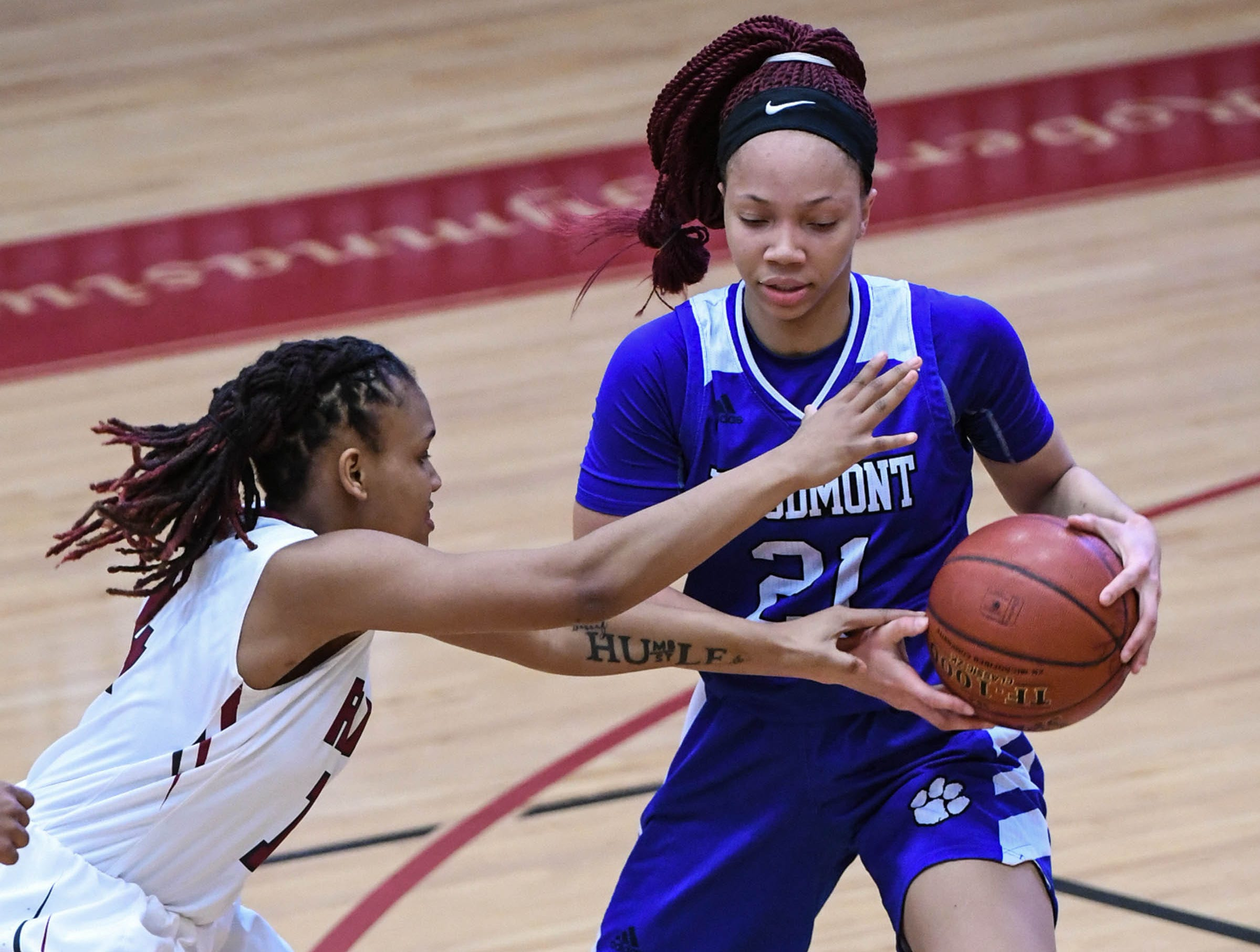 Woodmont junior Sydney Wyatt(21) dribbles near Westside junior Tatyana Lewis(14) during the first quarter at Westside High School in Anderson on Tuesday.