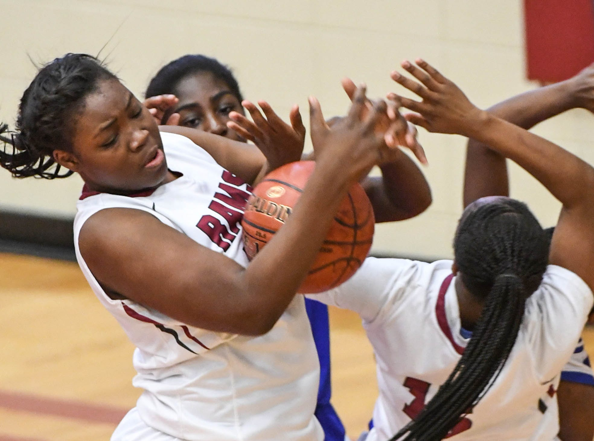 Westside sophomore Chyna Dixon(22) rebounds against Woodmont players during the first quarter at Westside High School in Anderson on Tuesday.