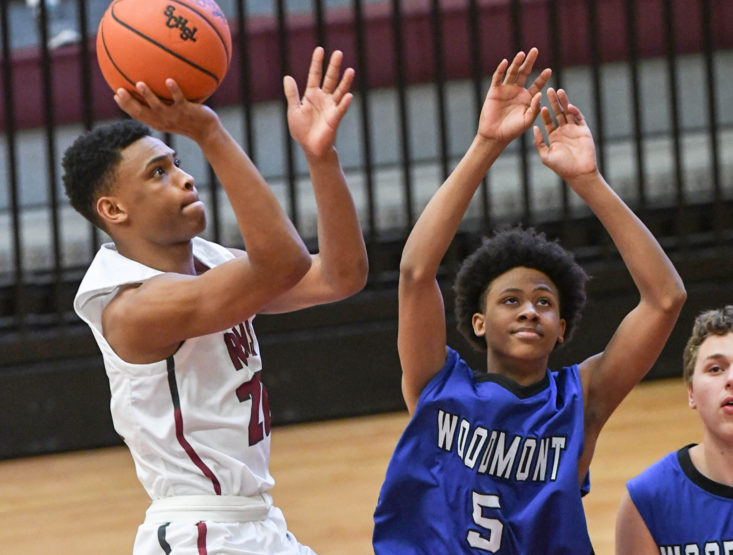 Westside senior Trystan Rice(20) shoots near Woodmont junior Pedrick Williams(5) during the fourth quarter at Westside High School in Anderson on Tuesday. Westside beat Woodmont 85-57.