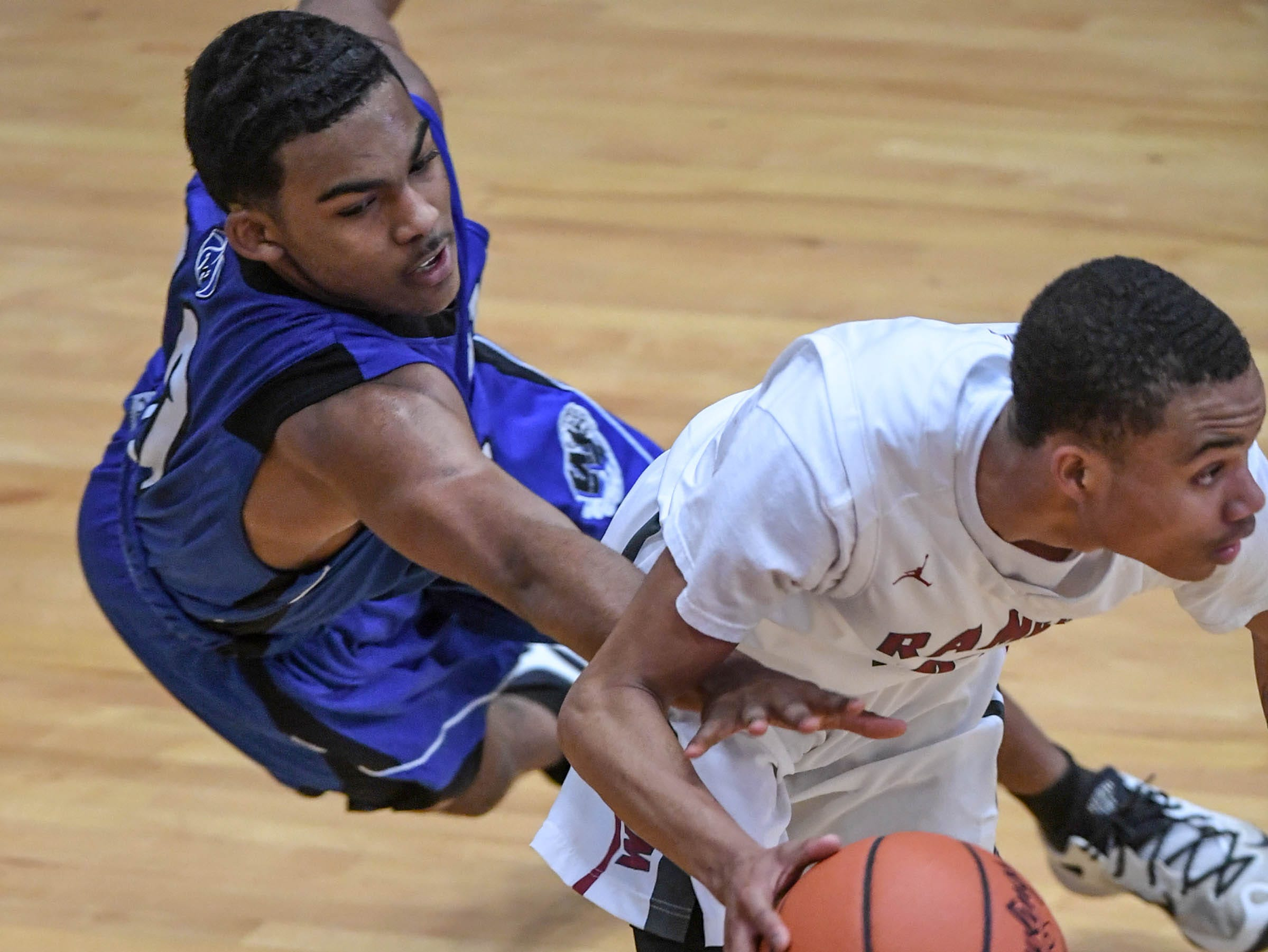Westside senior Odarius Cade(2) dribbles by Woodmont junior Ashton Arnold(10) during the fourth quarter at Westside High School in Anderson on Tuesday. Westside beat Woodmont 85-57.