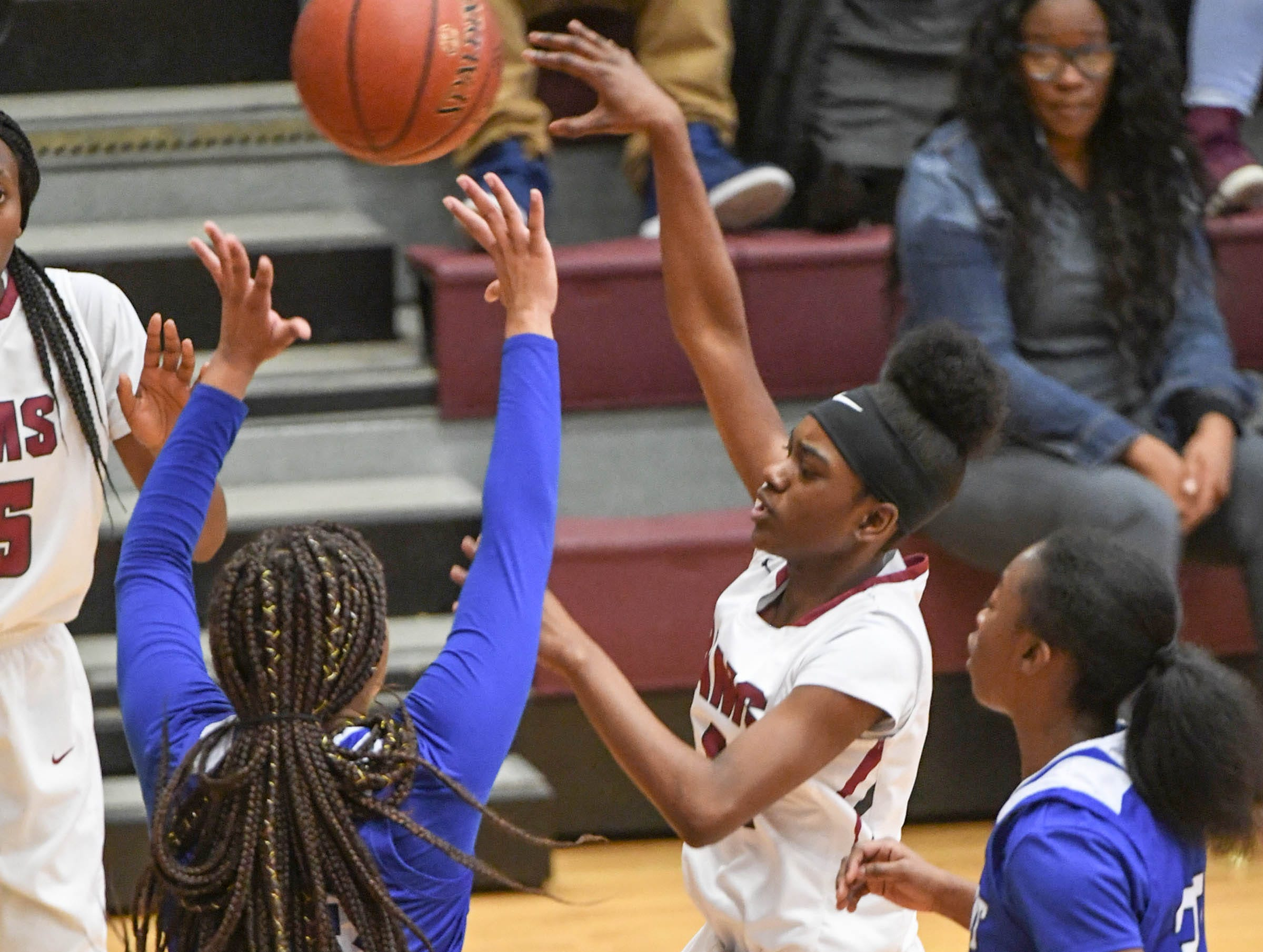 Westside freshman Aziyah Bell(4) passes the ball near Woodmont players during the first quarter at Westside High School in Anderson on Tuesday.