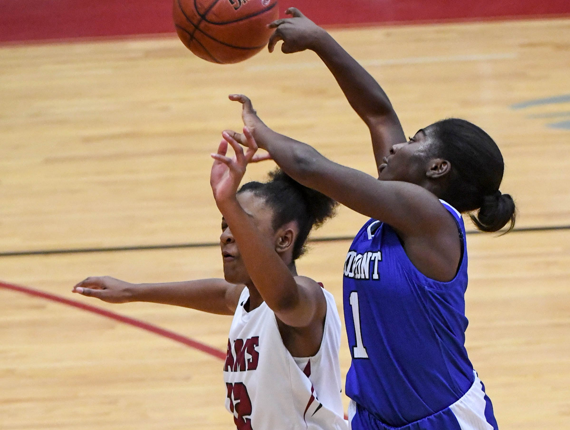 Westside freshman Branya Pruitt(12) and Woodmont freshman Mazari Bennett(1) reach for a loose ball during the third quarter at Westside High School in Anderson on Tuesday.
