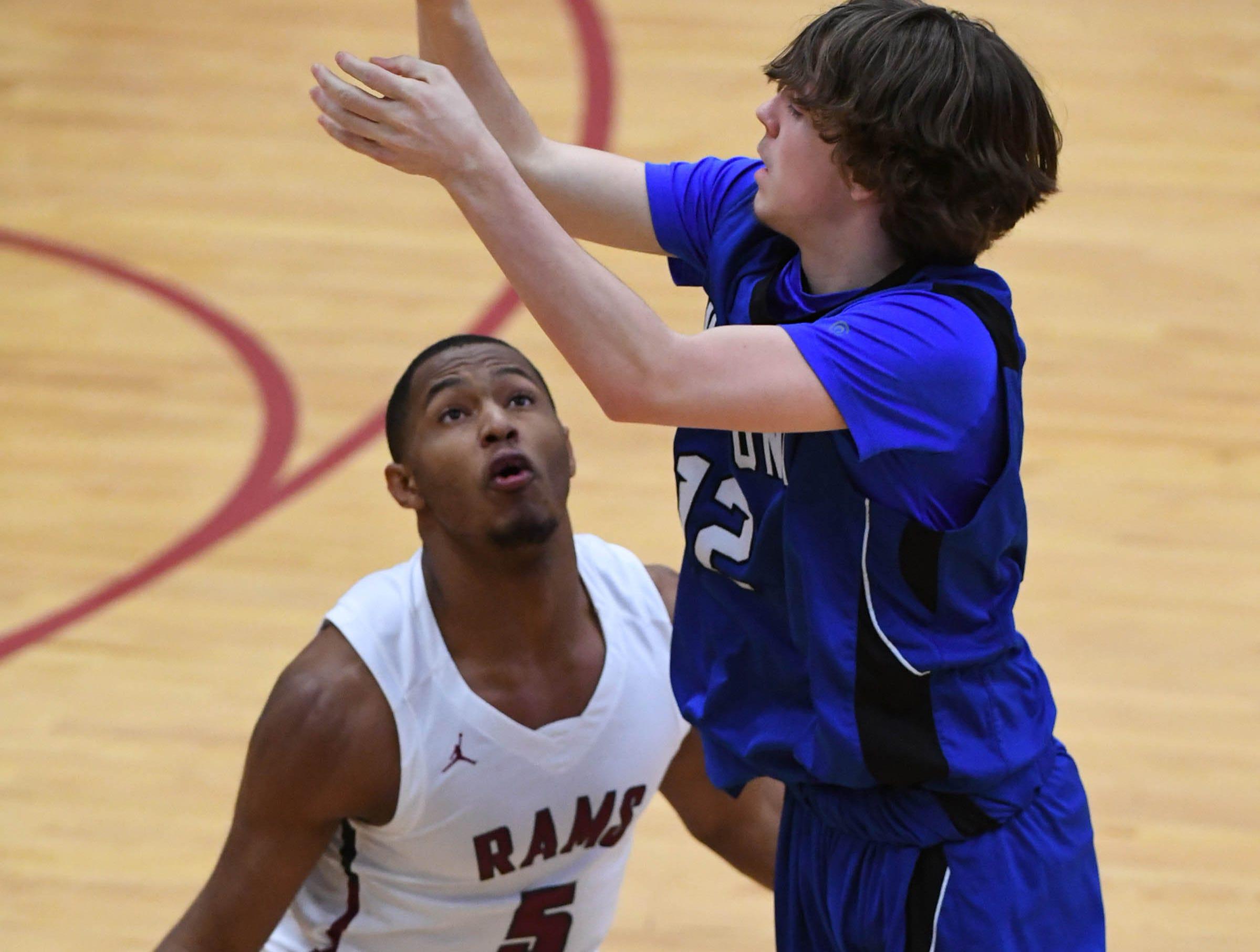Westside senior Tim Johnson(5) defends Woodmont junior Spencer McAlister(12) during the fourth quarter at Westside High School in Anderson on Tuesday.
