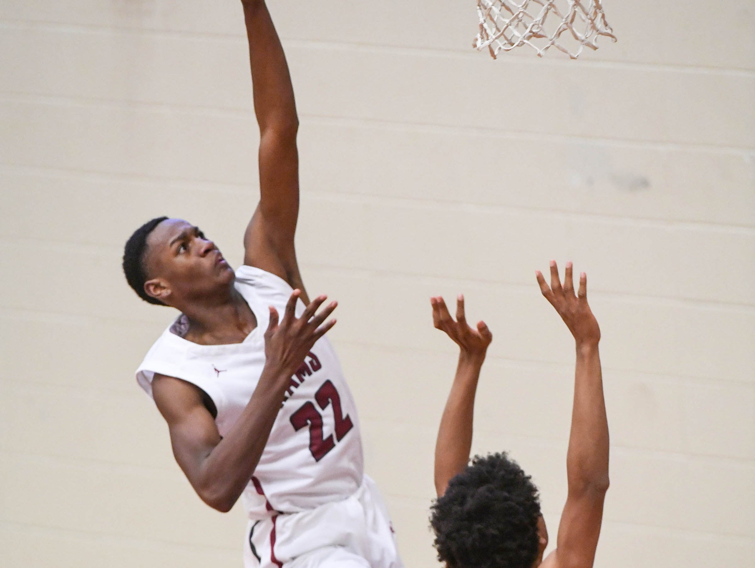 Westside sophomore Xavier Thornton(22) shoots near Woodmont junior Pedrick Williams(5) during the fourth quarter at Westside High School in Anderson on Tuesday. Westside beat Woodmont 85-57.