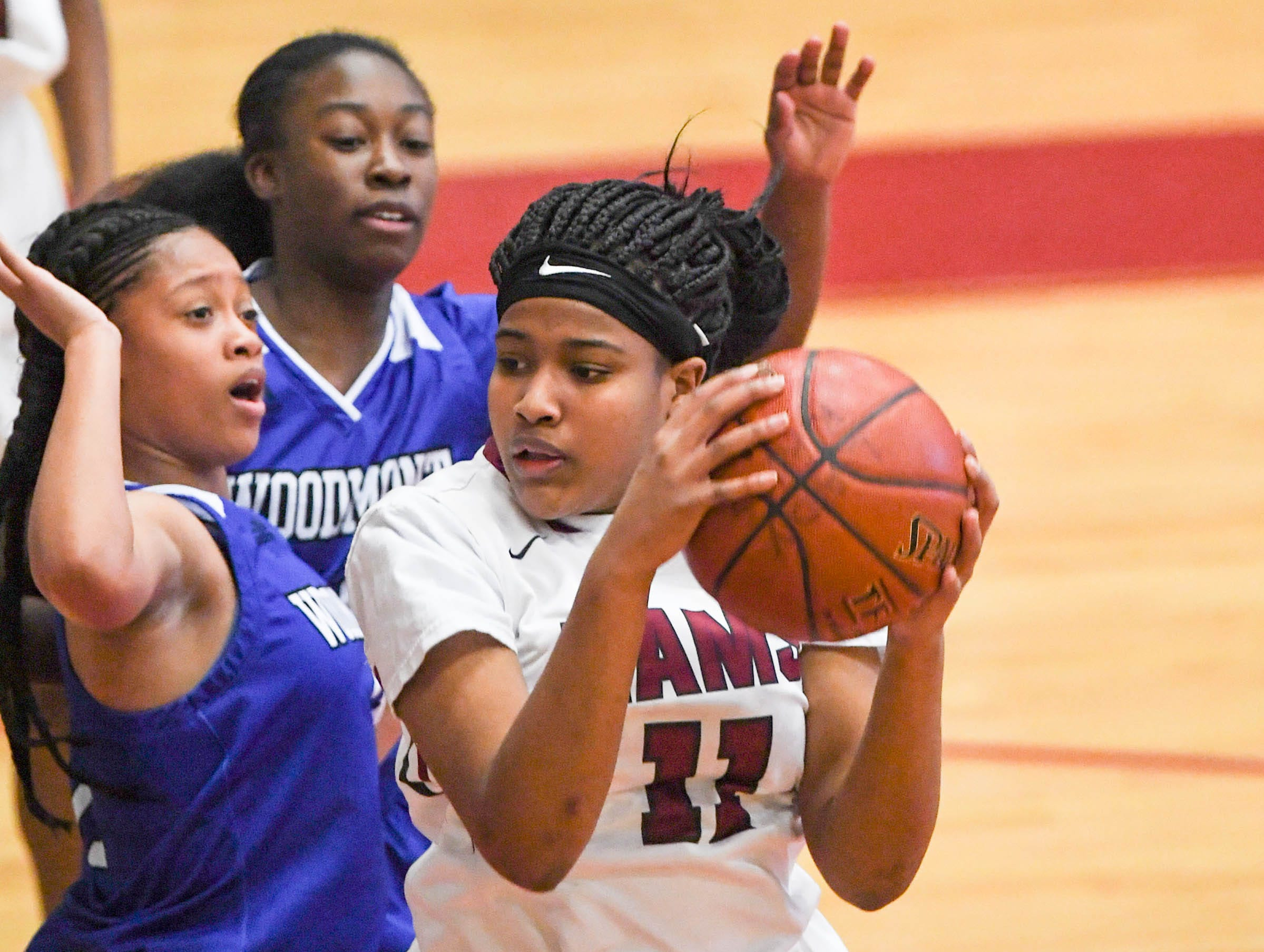 Westside freshman Destiny Middleton(11) dribbles near Woodmont sophomore Charlee Brewster(2) during the first quarter at Westside High School in Anderson on Tuesday.