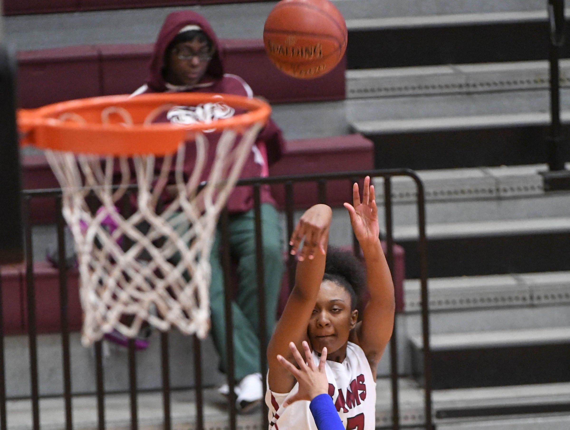 Westside freshman Branya Pruitt(12) shoots near Woodmont senior Kitara Henry(33) during the third quarter at Westside High School in Anderson on Tuesday.