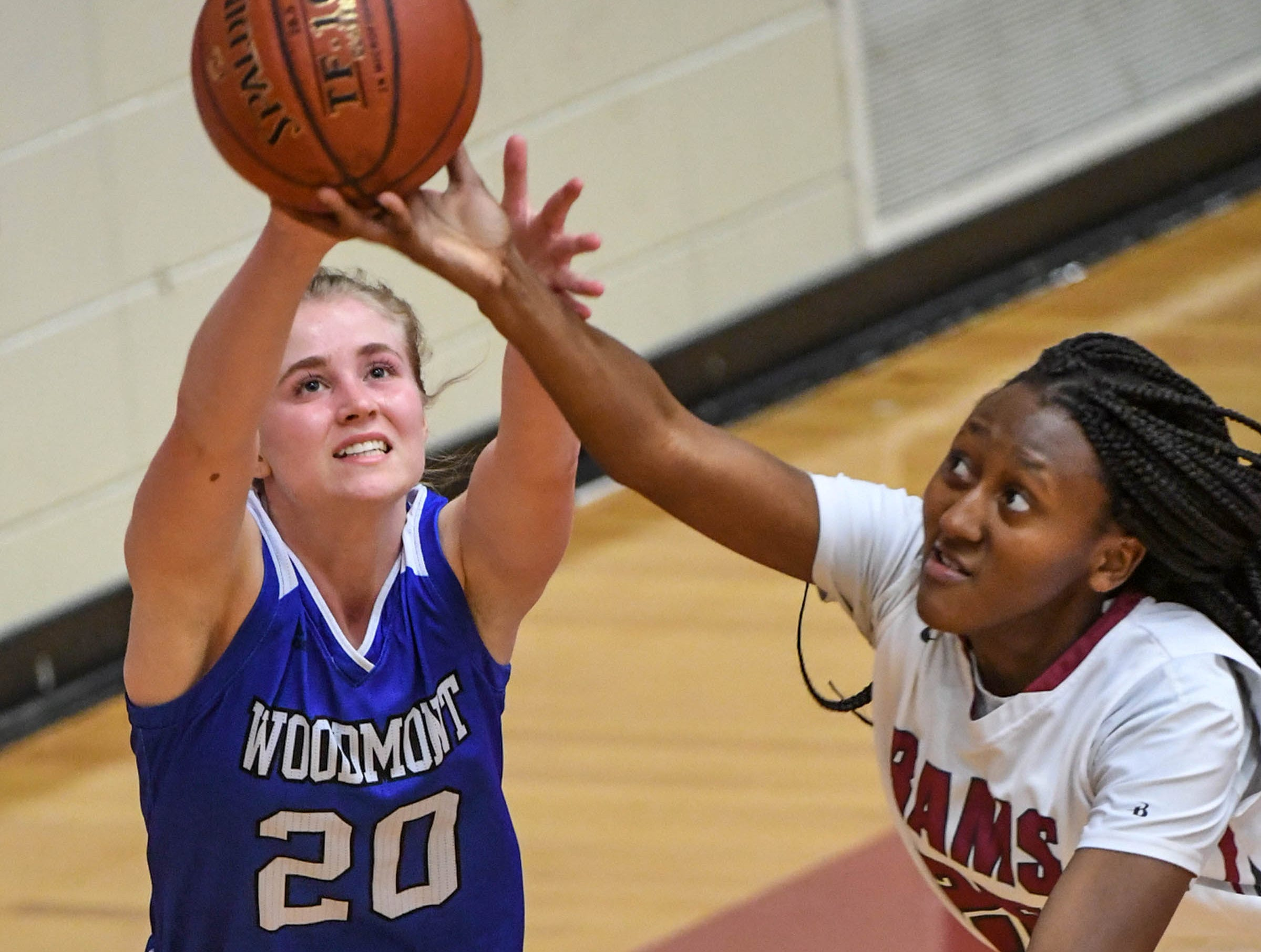 Woodmont senior Xan Rowland(20), left, and Westside junior Keyshuna Fair(25) reach for a loose ball during the third quarter at Westside High School in Anderson on Tuesday.