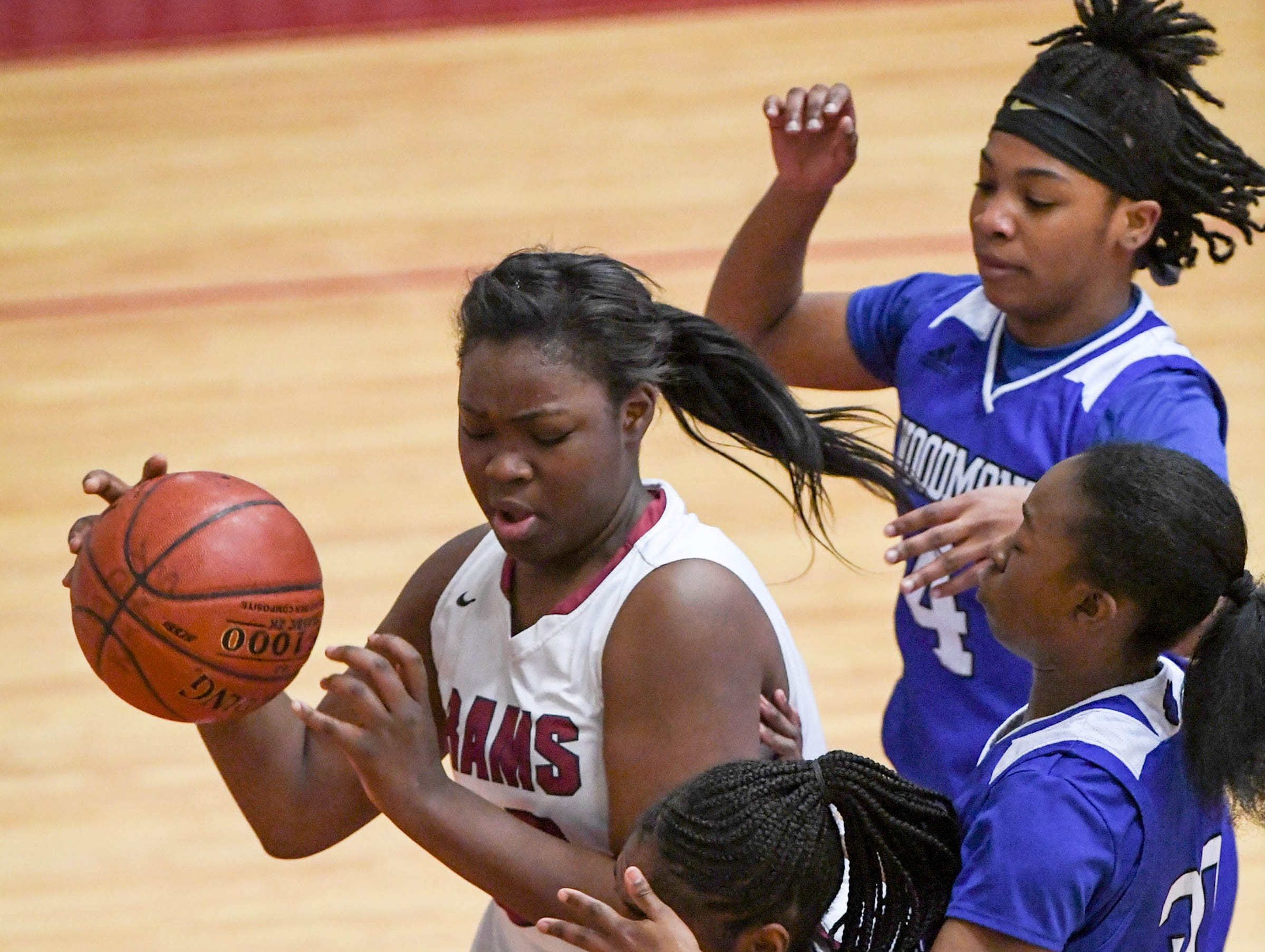 Westside sophomore Chyna Dixon(22) controls the ball near Woodmont junior JaRae Smith(30) during the first quarter at Westside High School in Anderson on Tuesday.