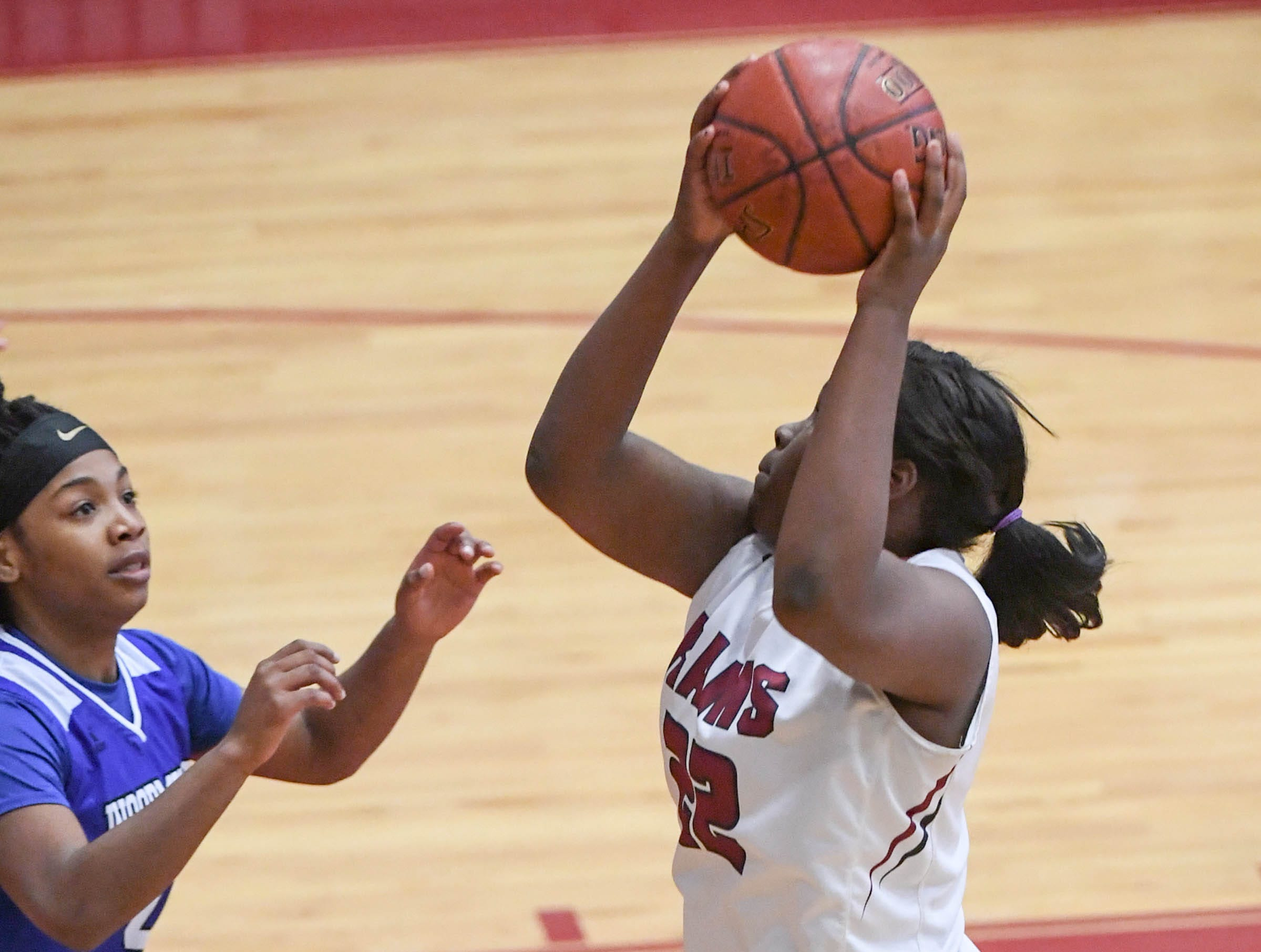 Westside sophomore Chyna Dixon(22) shoots near Woodmont junior Jordan Hagood(4) during the first quarter at Westside High School in Anderson on Tuesday.