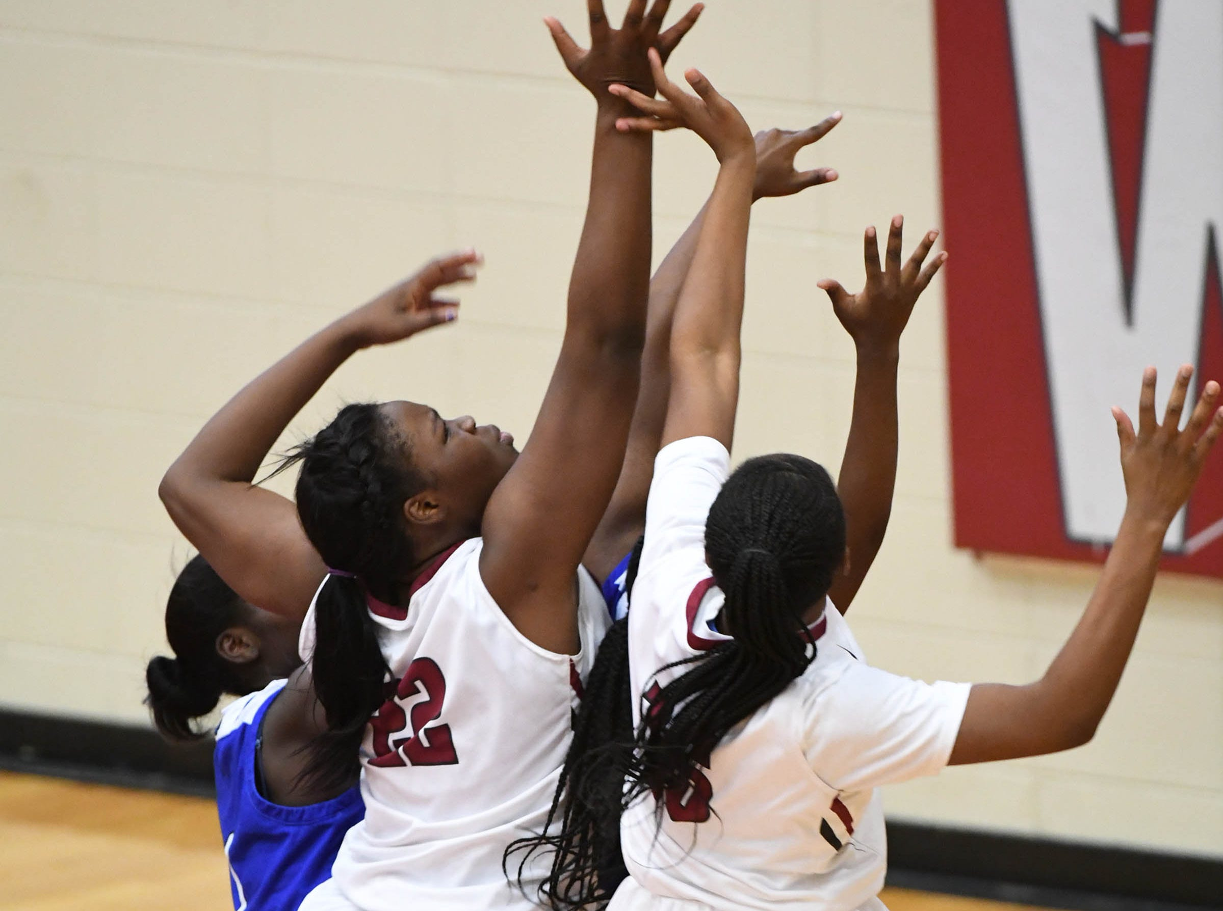 Westside sophomore Chyna Dixon(22) shoots near Woodmont players during the first quarter at Westside High School in Anderson on Tuesday.