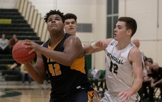 Toms River North's Najea Hallenbeck looks to go up strong to the hoop while Brick Memorial's Kyle McMahon guards him. Toms River North Boys Basketball vs Brick Memorial in Brick, NJ on January 29, 2019.