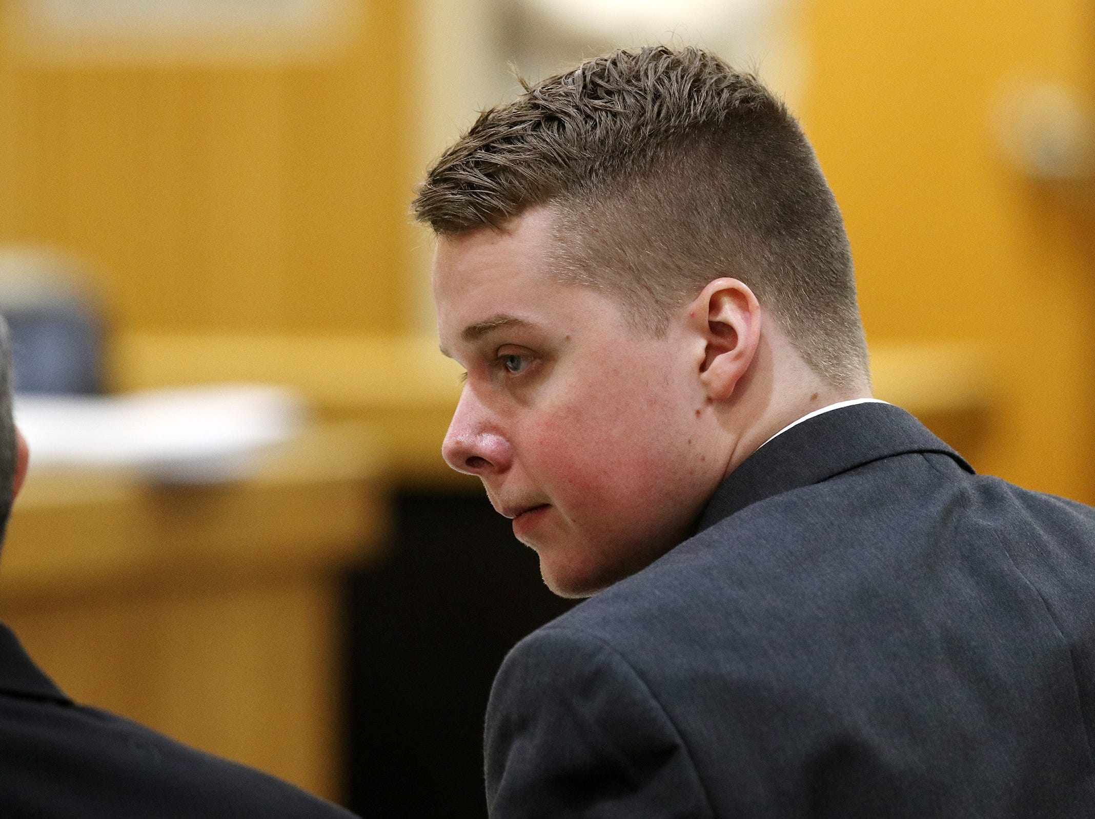 Liam McAtasney, who is charged with the murder of former high school classmate, Sarah Stern, speaks to his lawyer, Carlos Diaz-Cobo, during his trial before Superior Court Judge Richard W. English at the Monmouth County Courthouse in Freehold, NJ Wednesday January 30, 2019.