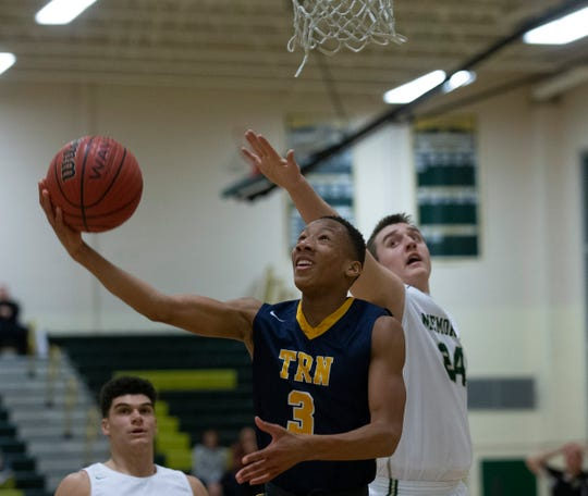 Toms River North's Jakari Spence goes up with a shot from under the basket during second half action. Toms River North Boys Basketball vs Brick Memorial in Brick, NJ on January 29, 2019.
