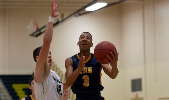 Toms River North's Jakari Spence goes up for a layup against Brick Memorial. Toms River North Boys Basketball vs Brick Memorial in Brick, NJ on January 29, 2019.