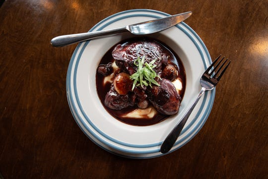 At Pascal & Sabine in Asbury Park, coq au Vin is served in a red wine sauce with mushrooms, pearl onions and  pommes purée.