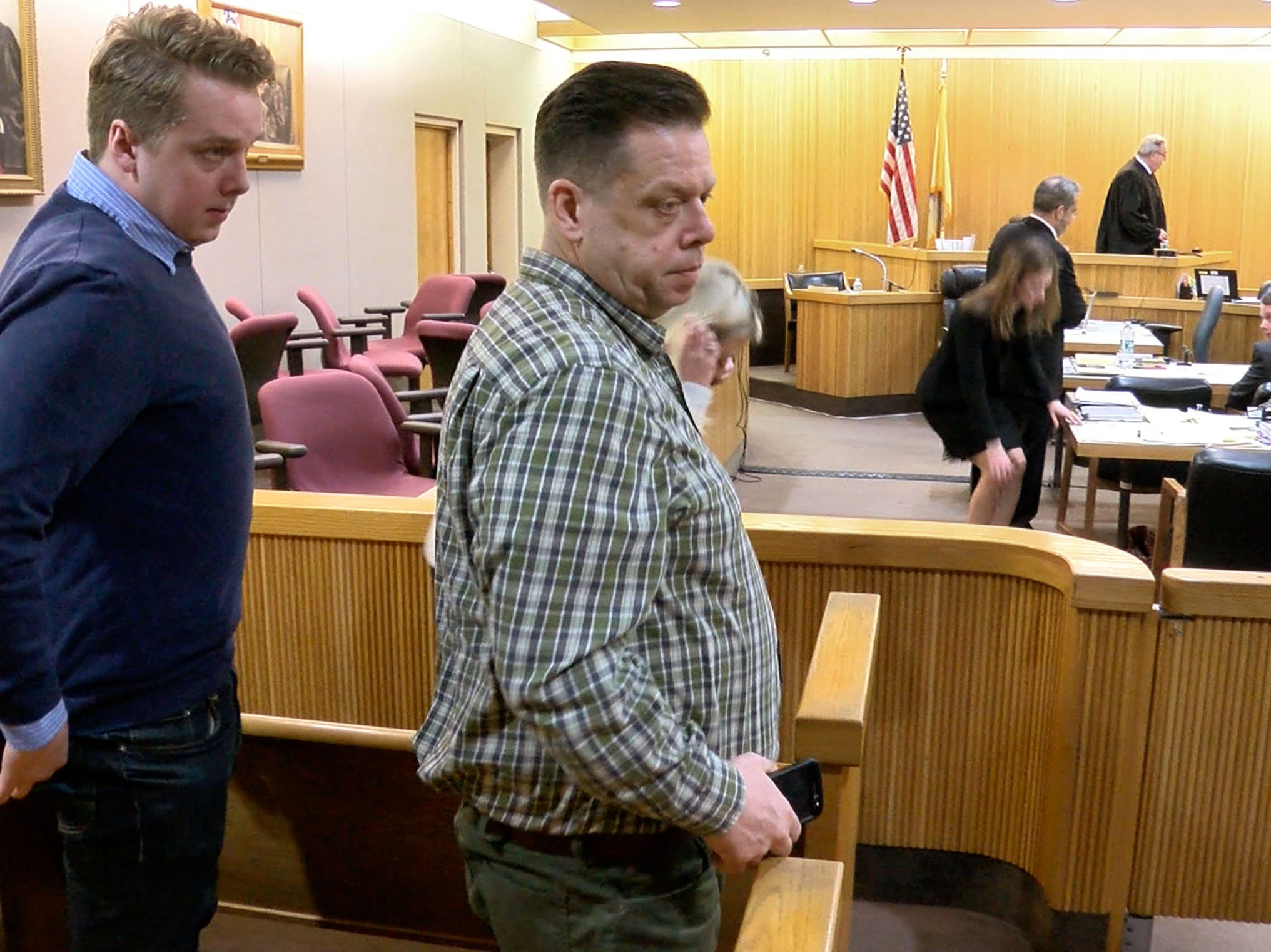 Liam McAtasney looks back to the gallery as his father Quinn McAtasney and twin brother Seamus leave Superior Court Judge Richard English's courtroom in Freehold Wednesday, January 30, 2019.  Liam McAtasney is on trial for the 2016 murder of Sarah Stern.