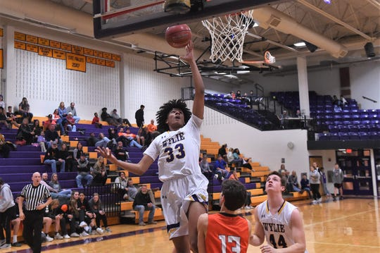 Wylie's Deandre Bone (33) goes over an Aledo defender for a shot during Tuesday's game. The Bulldogs won 60-43 to pull into a tie for second place in District 4-5A.