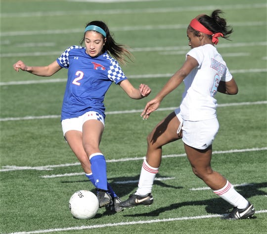 Cooper's Hayden Abor, left, battles Wichita Falls Hirschi's Skyy Lee for the ball. Abor matched a career high with five goals in the Lady Cougars' 10-0 victory over Hirschi in the nondistrict game Tuesday, Jan. 29, 2019, at Shotwell Stadium.