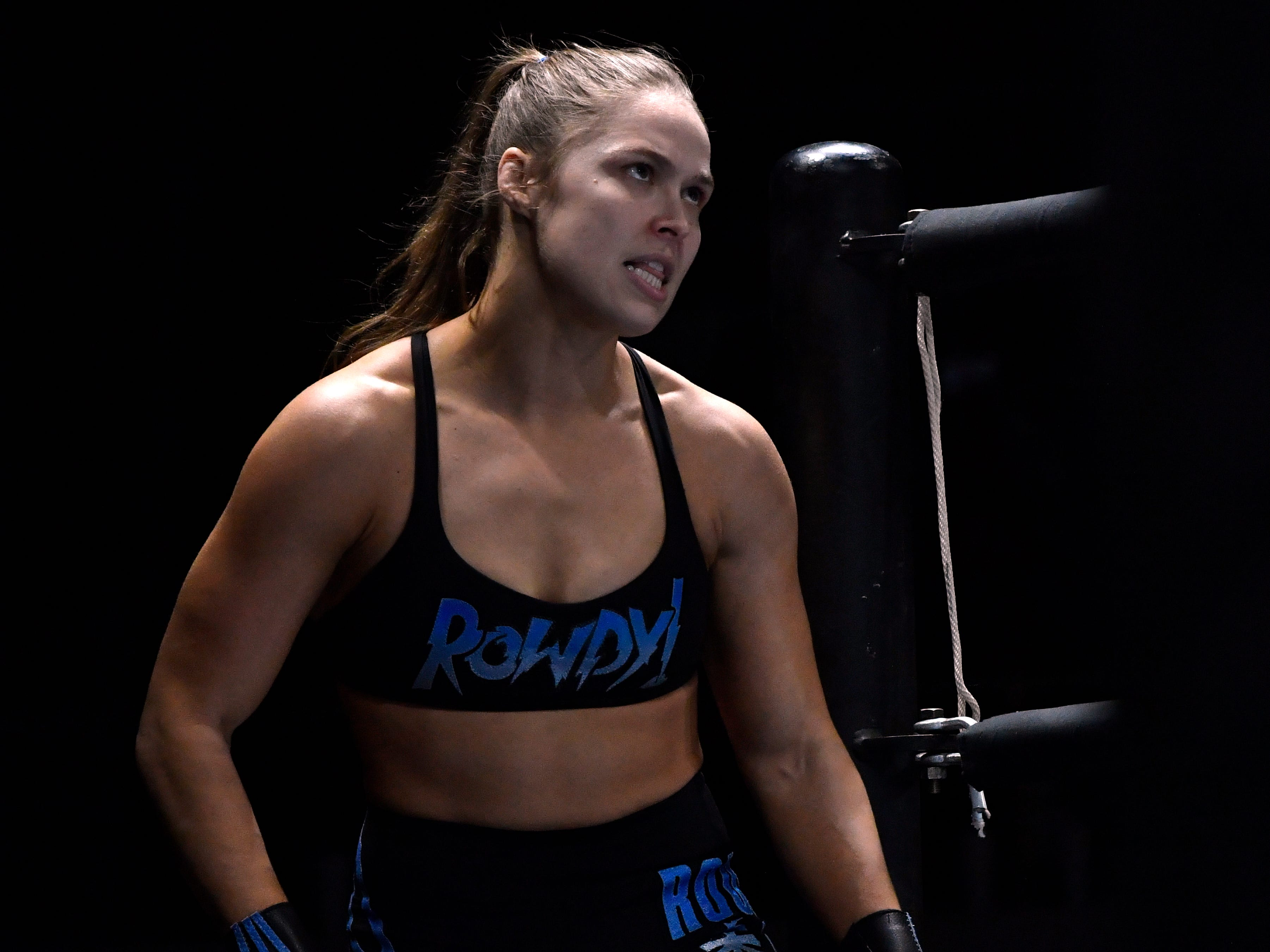 """Rowdy"" Ronda Rousey climbs into the ring during Saturday's WWE Live wrestling event Jan. 19, 2019. Held at the Taylor County Coliseum, the evening featured a colorful array of World Wrestling Entertainment stars."