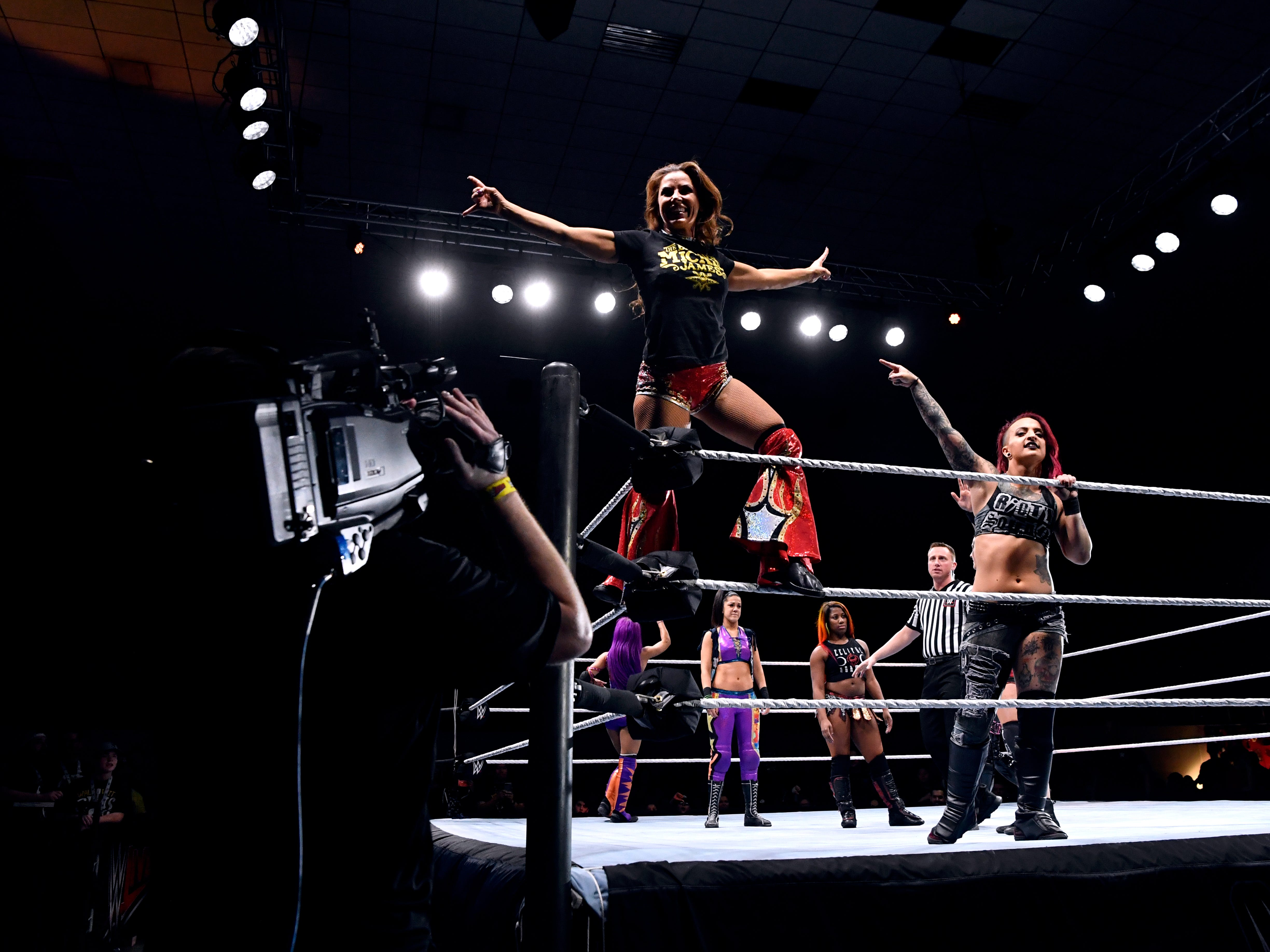 Ruby Riott points to Mickie James standing on the corner ropes before the start of a women's match during Saturday's WWE Live wrestling event Jan. 19, 2019. Held at the Taylor County Coliseum, the evening featured a colorful array of World Wrestling Entertainment stars.