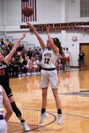 Wylie's Karis Christian (12) puts up a shot against Aledo in a District 4-5A contest at Bulldog Gym. Christian scored six points in the overtime loss.