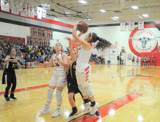 Eastland junior Makenna Moreno, center, rises for a shot in the first half Tuesday, Jan. 29, 2019, against Cisco.