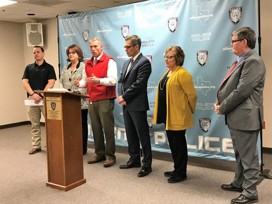 Abilene Police Chief Stan Standridge speaks at a news conference on a mew strangulation protocol to help domestic violence victims Wednesday.  The protocol is an effort of the Abilene/Taylor County Alliance to End Family Violence. Also pictured (from left) are Sgt. Mike Moschetto, Abilene Police Department; Janey Wawerna, executive director of Abilene's Regional Crime Victim Crisis Center; Dan Joiner, Taylor County district attorney's Office; Susie Striegler, coordinator of forensic nursing at Hendrick Medical Center; and Dan Cox, executive director of Noah Project of Abilene.