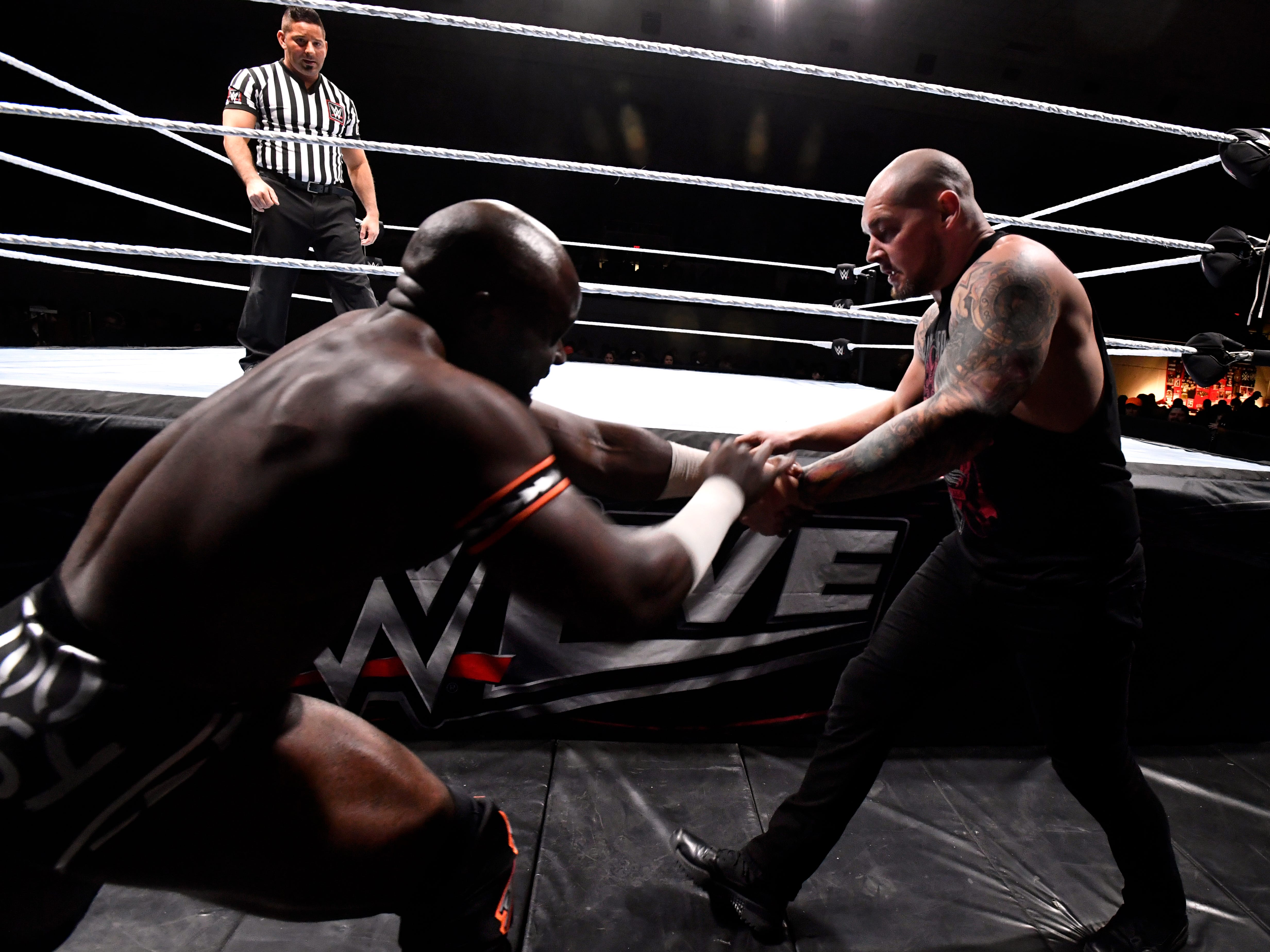 Apollo Crews (left) squares-off with Baron Corbin outside of the ring during Saturday's WWE Live wrestling event Jan. 19, 2019. Held at the Taylor County Coliseum, the evening featured a colorful array of World Wrestling Entertainment stars.