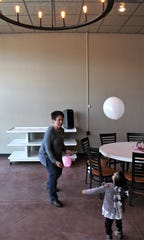 "Michelle bats a white balloon toward a hooped light fixture, hoping to send it through the ""goal"" at the Kessell Building in Slaton. The Guatemalan girl, 11, recently was in Houston to address serious medical issues."