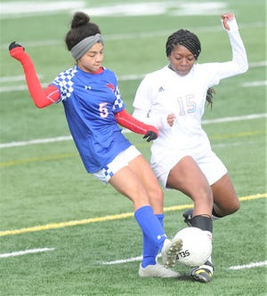 Cooper's Maddie Abor (5) fights Wichita Falls Hirschi's Rachel Carvil for the ball. The Lady Cougars beat Hirschi 10-0 in the nondistrict game Jan. 29 at Shotwell Stadium.