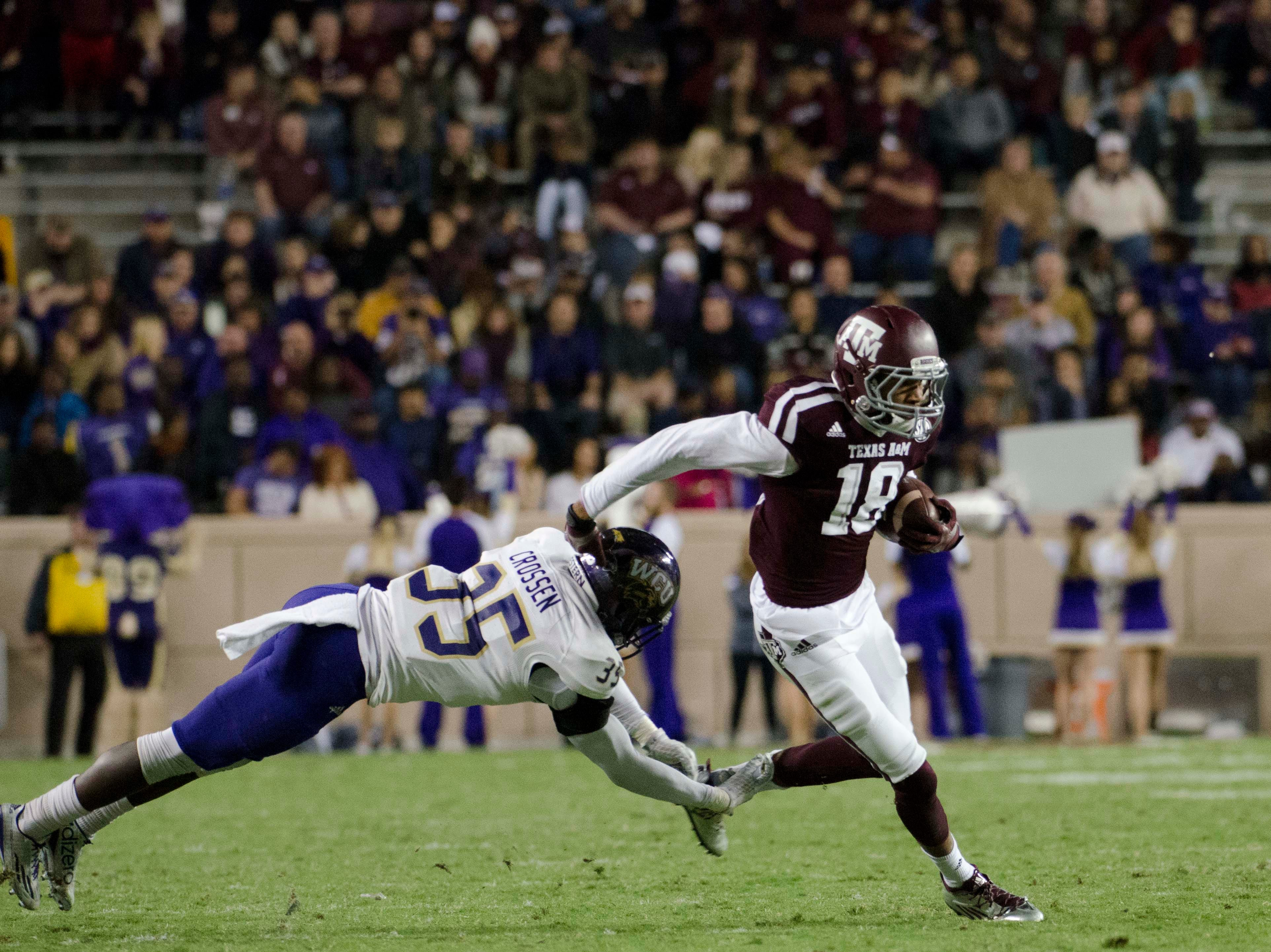 Nov 14, 2015; College Station, TX, USA; Texas A&M Aggies wide receiver Edward Pope (18) avoids a tackle by Western Carolina Catamounts cornerback Keion Crossen (35) during the second half at Kyle Field. Texas A&M beat Western Carolina 41-17. Mandatory Credit: Brendan Maloney-USA TODAY Sports