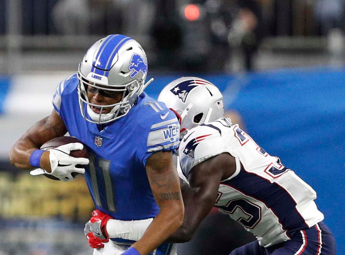Sep 23, 2018; Detroit, MI, USA; Detroit Lions wide receiver Marvin Jones (11) gets tackled by New England Patriots defensive back Keion Crossen (35) during the second quarter at Ford Field. Mandatory Credit: Raj Mehta-USA TODAY Sports