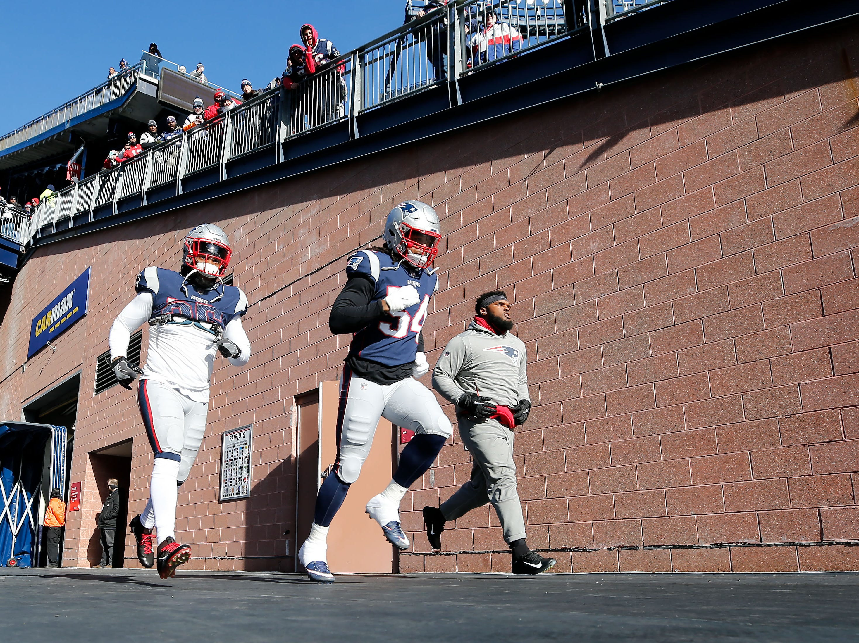 Jan 13, 2019; Foxborough, MA, USA; New England Patriots outside linebacker Dont'a Hightower (54) and defensive back Keion Crossen (35) walk onto the field for warmups before a game against the Los Angeles Chargersin an AFC Divisional playoff football game at Gillette Stadium. Mandatory Credit: Winslow Townson-USA TODAY Sports