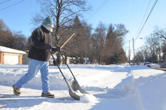 John Comeau uses his snow scoop to clear his driveway on Capital Ave. on Wednesday, January 30, 2019.